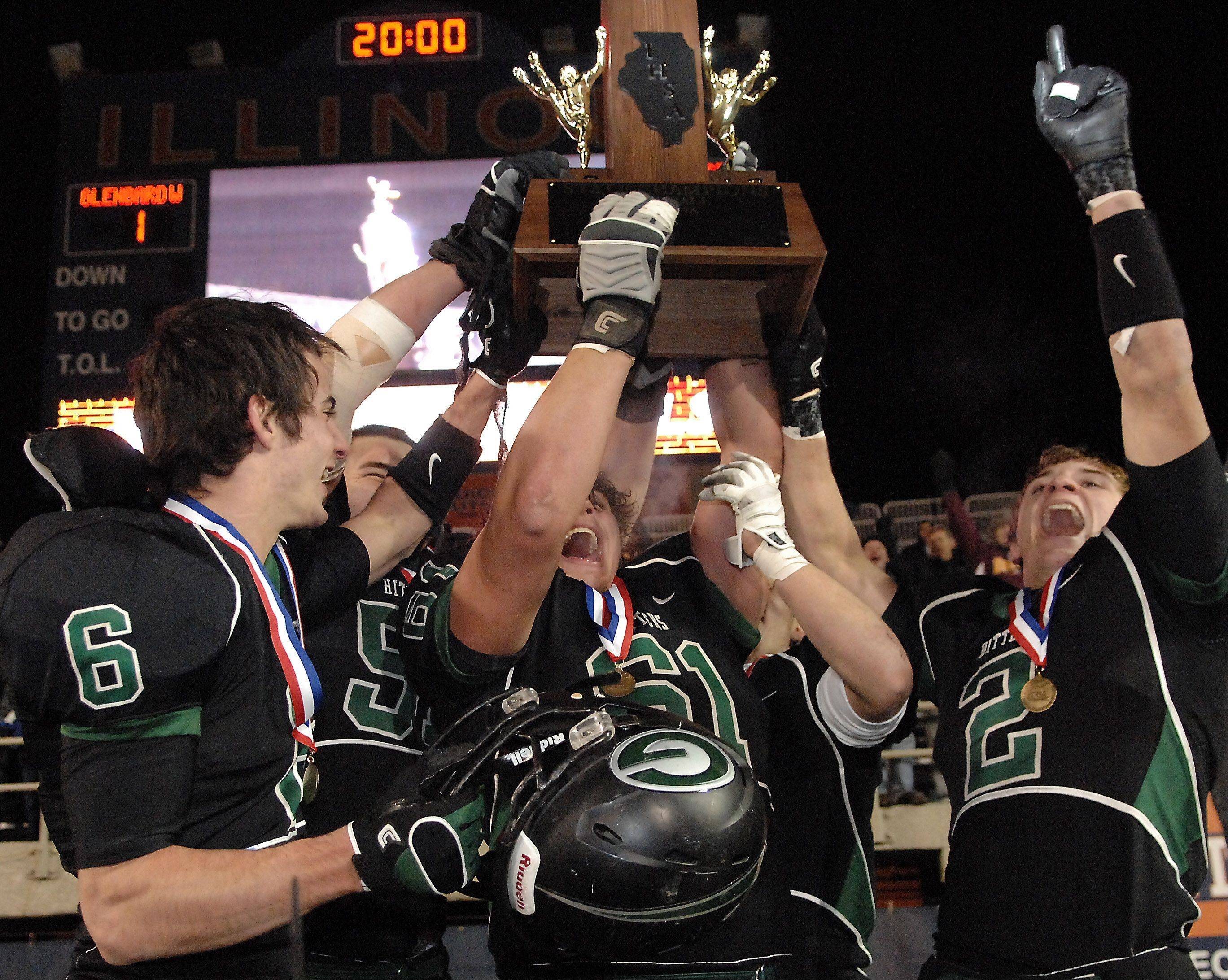 The Glenbard West captains hoist the championship trophy following their win over Lincoln-Way East during Saturday's Class 7A state title game at Memorial Stadium in Champaign.