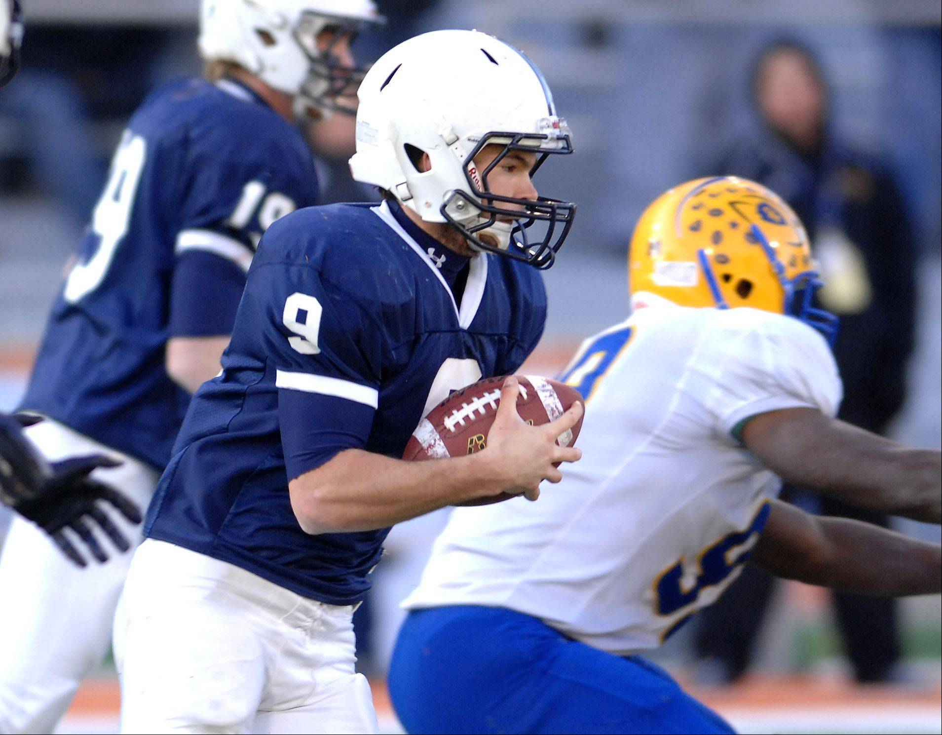 Cary-Grove's Quinn Baker (9) finds some running room around the corner against Crete-Monee during Saturday's Class 6A state title game at Memorial Stadium in Champaign.