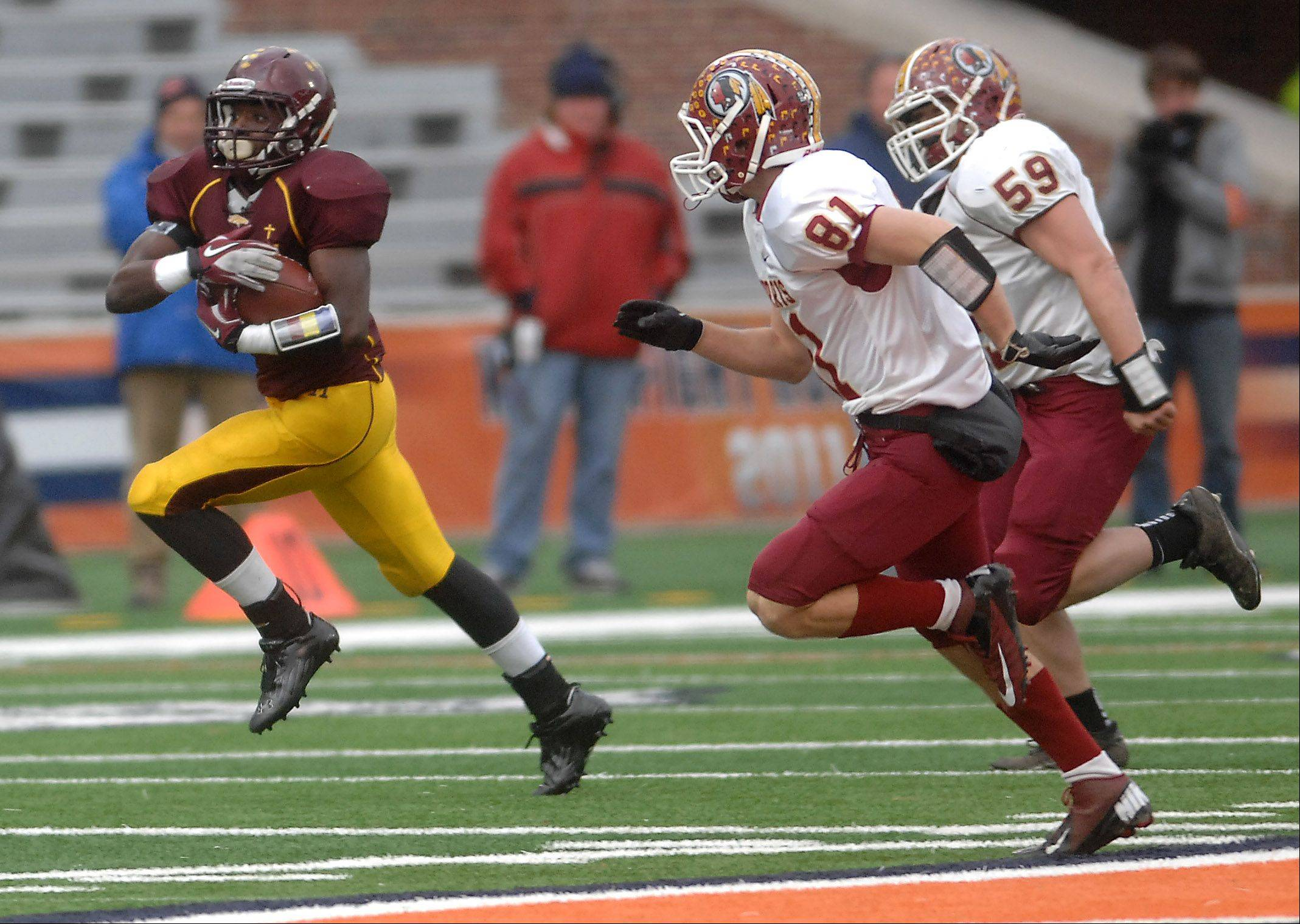 Montini running back Dimitri Taylor (23) breaks free from the Morris pursuit for a 73-yard touchdown run during Saturday's Class 5A state title game at Memorial Stadium in Champaign.