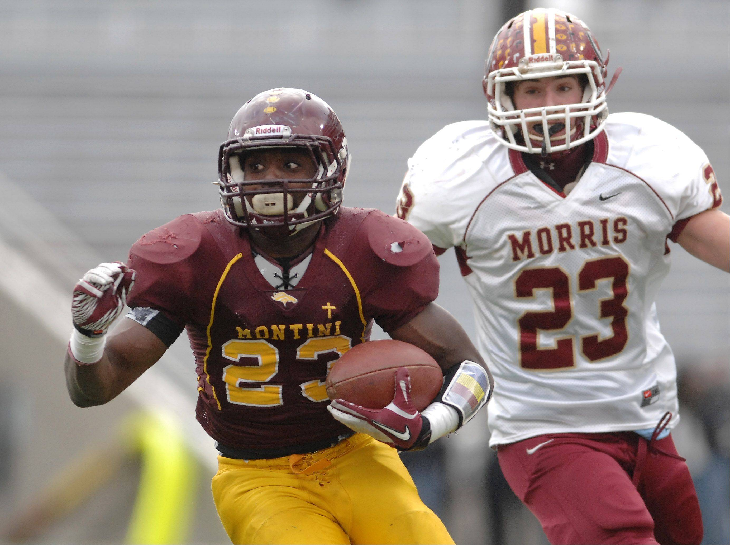 Montini's Dimitri Taylor (23) looks for room to run against Morris during Saturday's Class 5A state title game at Memorial Stadium in Champaign.