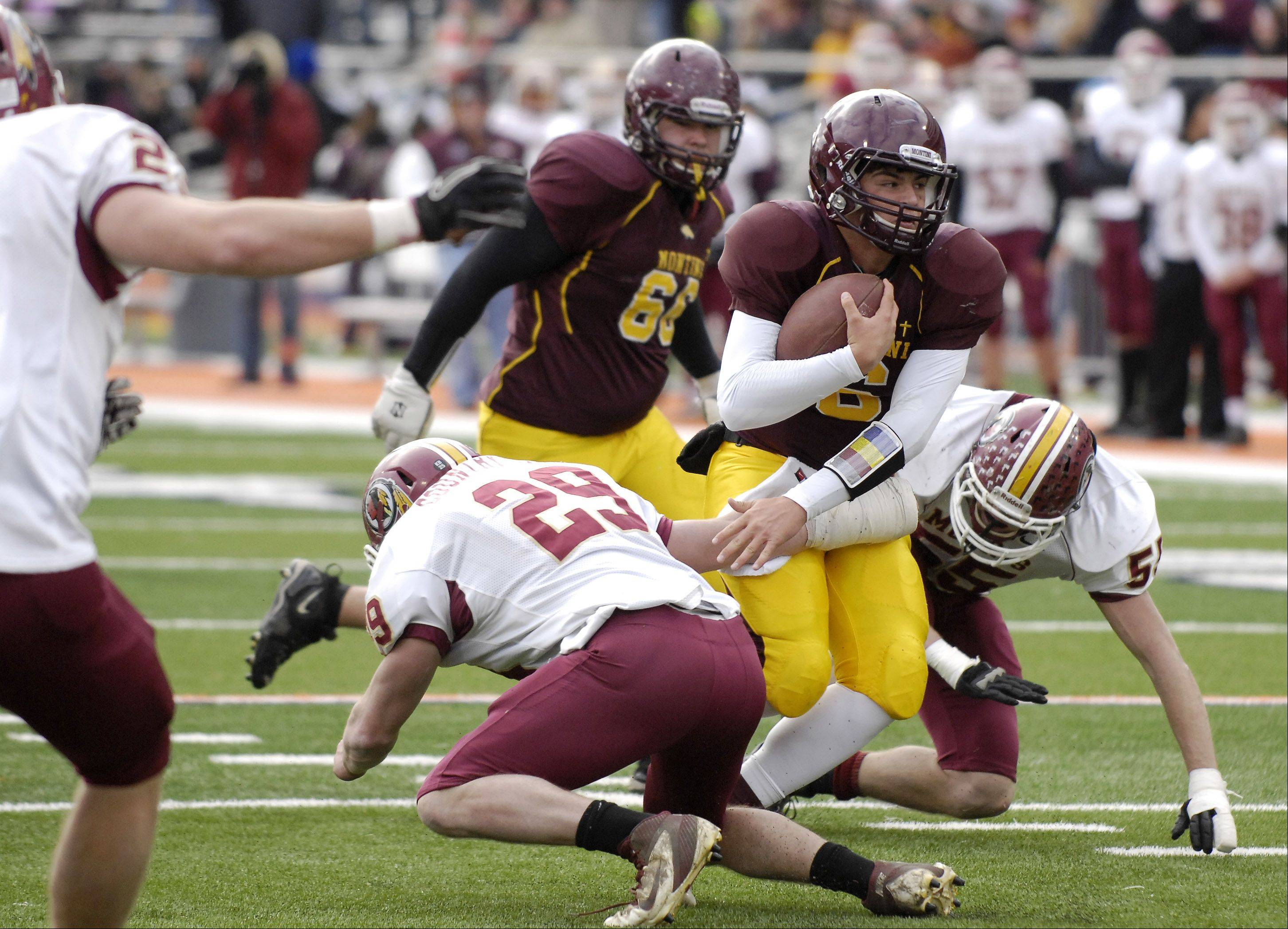 Montini quarterback Alexander Wills (6) finds a lane up the middle against Morris during Saturday's Class 5A state title game at Memorial Stadium in Champaign.