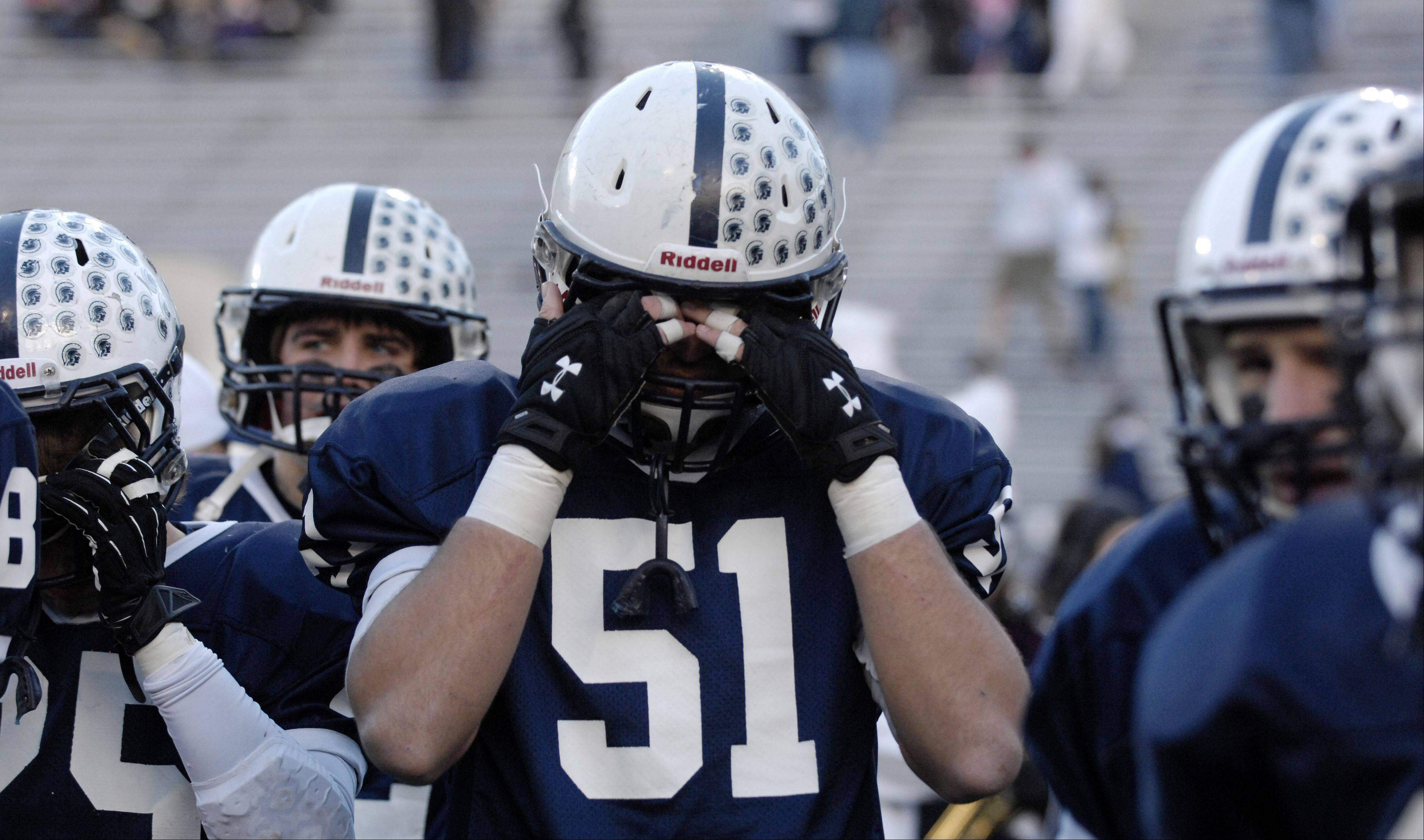 Cary-Grove's Kyle Matthiesen (51) and his teammates react to their 33-26 loss to Crete-Monee in Saturday's Class 6A state title game at Memorial Stadium in Champaign.