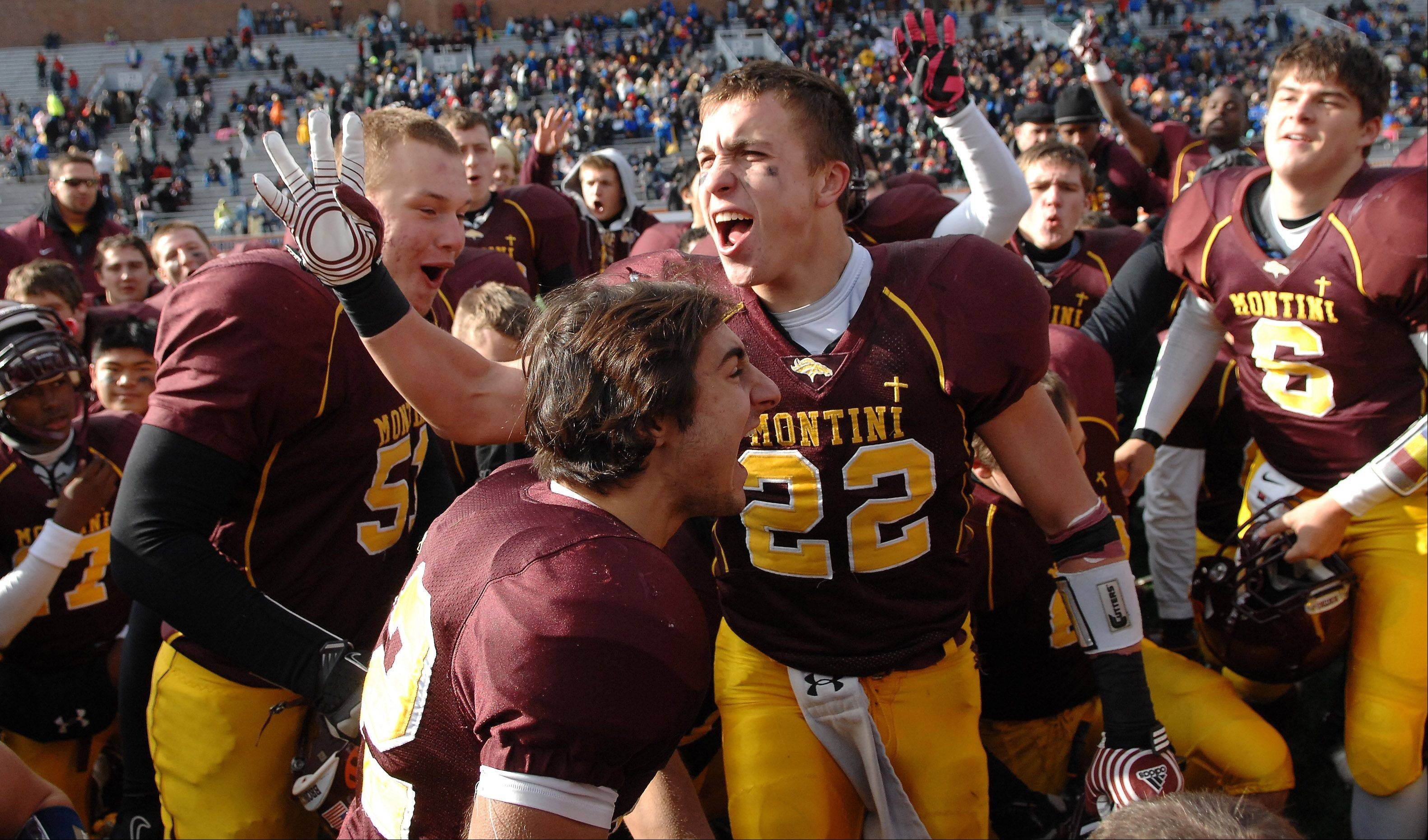 Montini's Ryan Starbeck (22) and his teammates celebrate after their win over Morris during Saturday's Class 5A state title game at Memorial Stadium in Champaign.