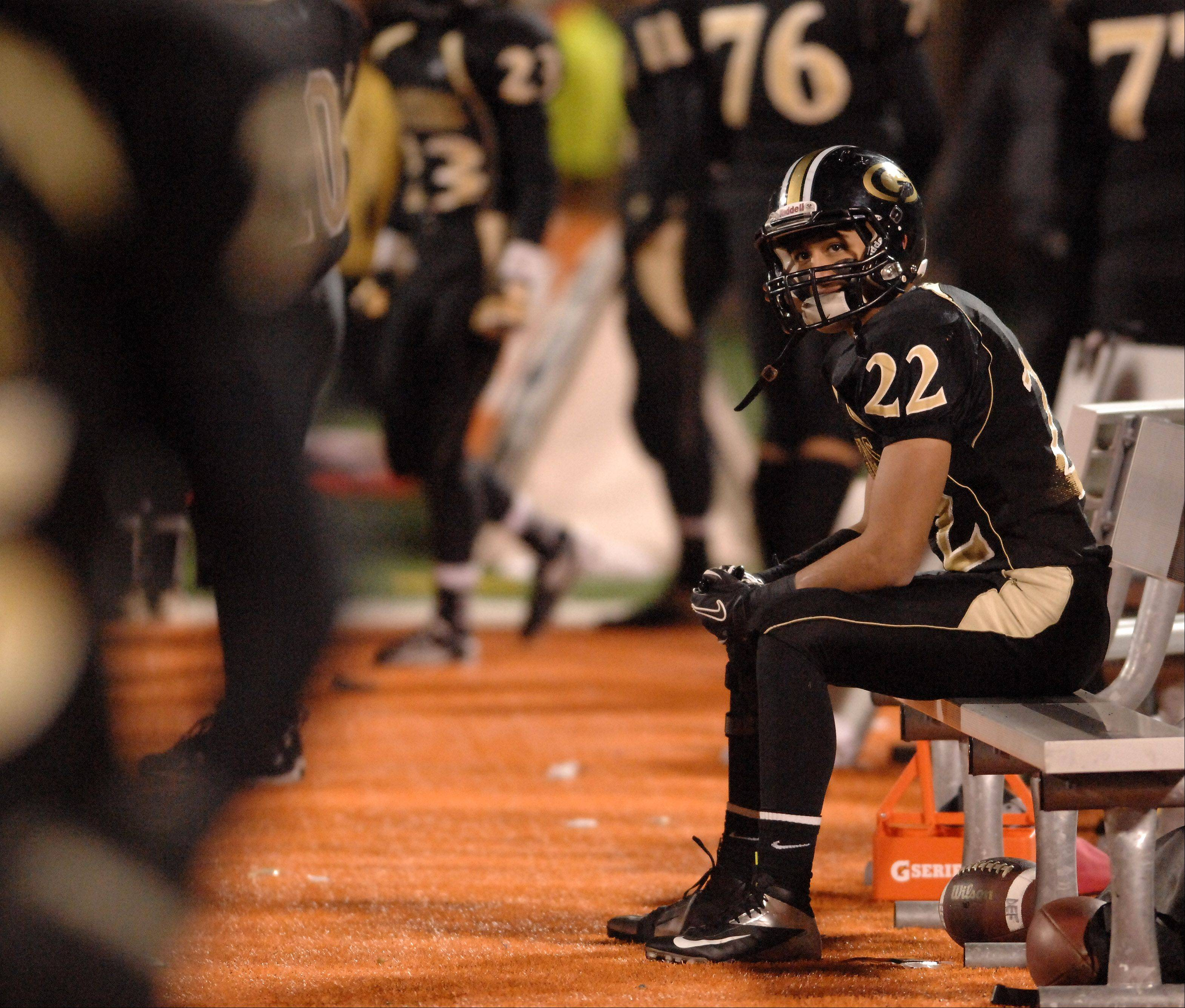 Glenbard North's Mario Rodriguez sits alone on the bench in the waning minutes of Saturday's Class 8A state title game at Memorial Stadium in Champaign.