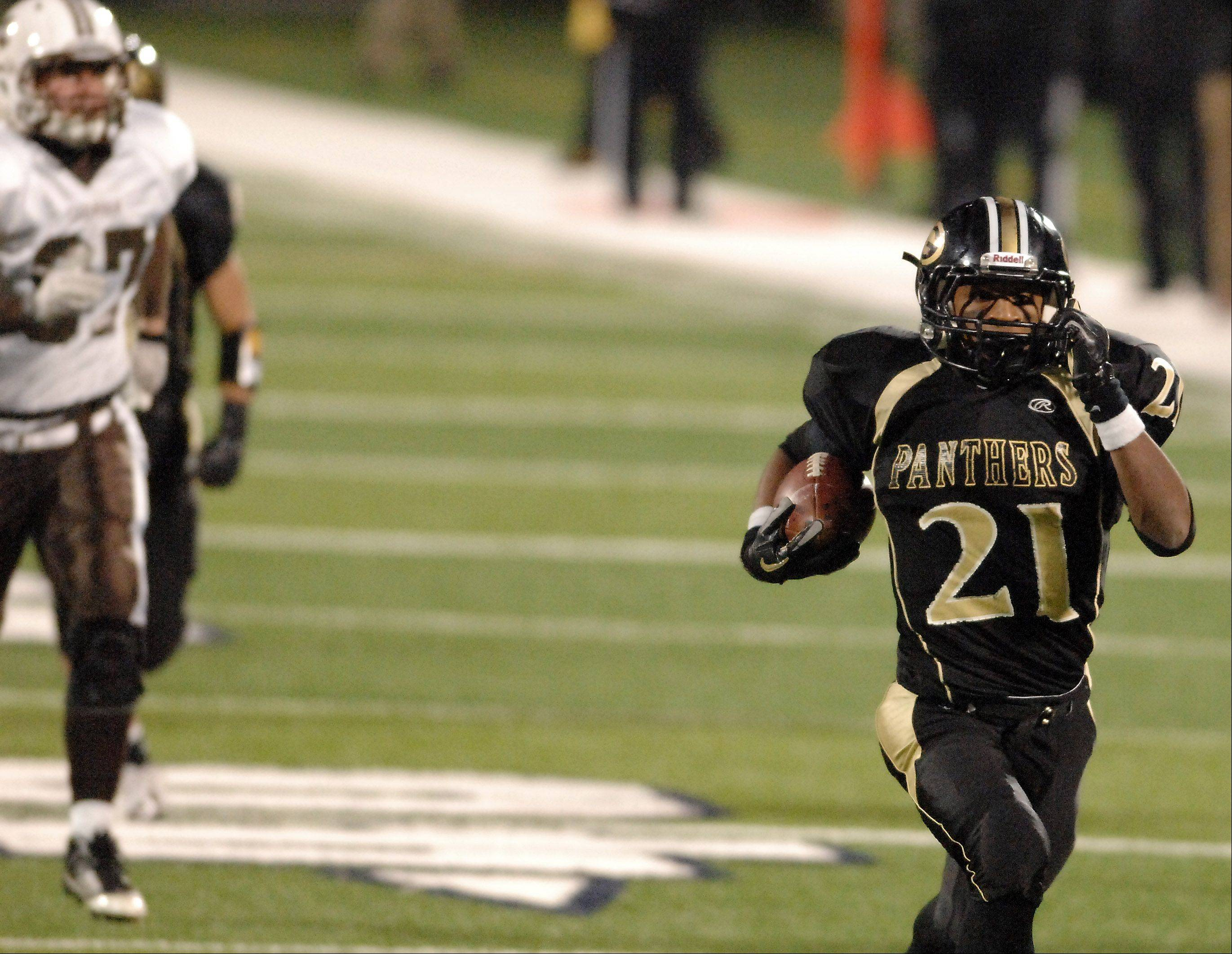 Glenbard North's Justin Jackson races to the end zone for a touchdown after aninterception during Saturday's Class 8A state title game at Memorial Stadium in Champaign.