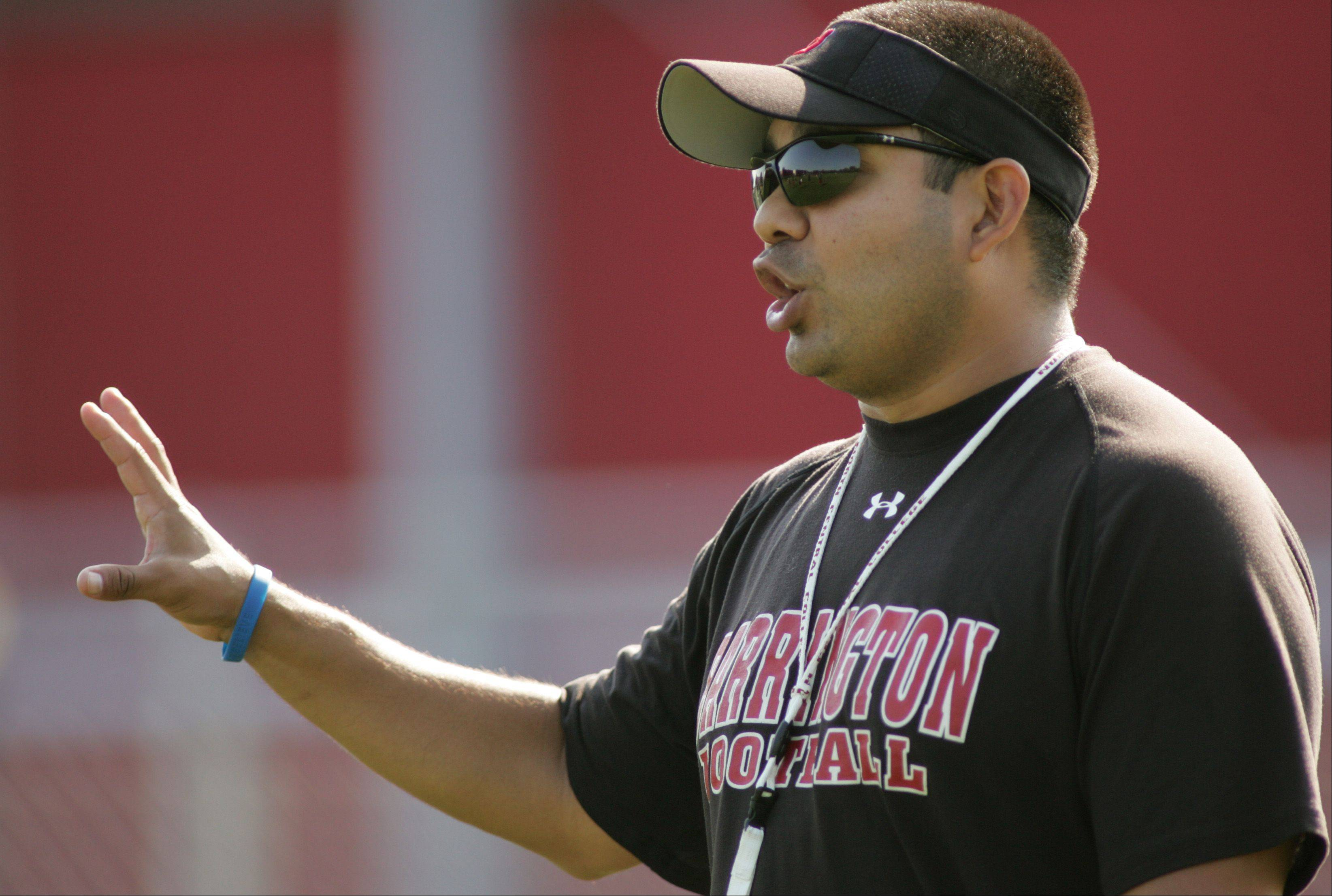 Coach Joe Sanchez runs varsity football practice at Barrington High School.