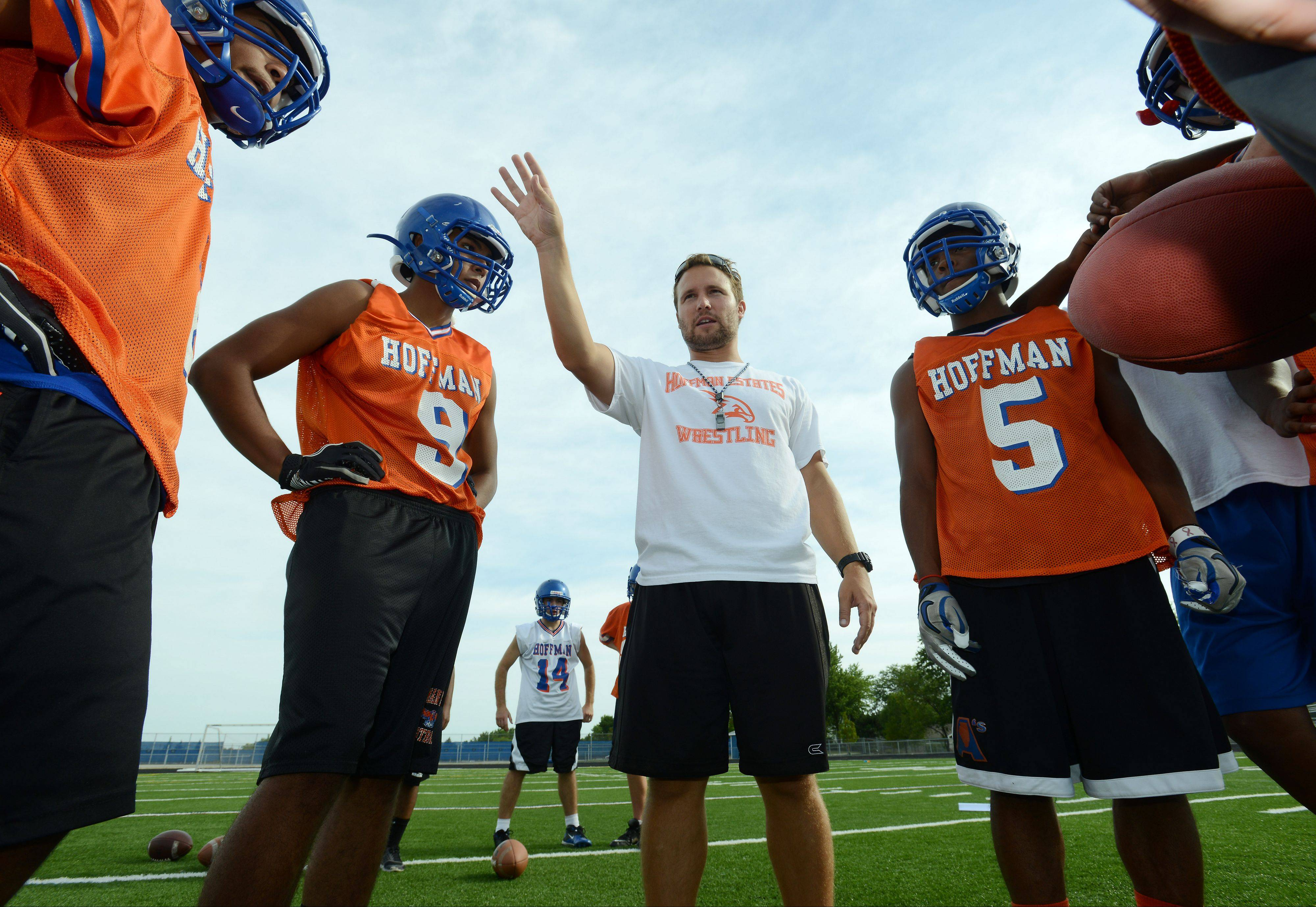 Eric Ilich directs players on the first day of practice last August at Hoffman Estates. Ilich is out as the Hawks' head coach after one season.