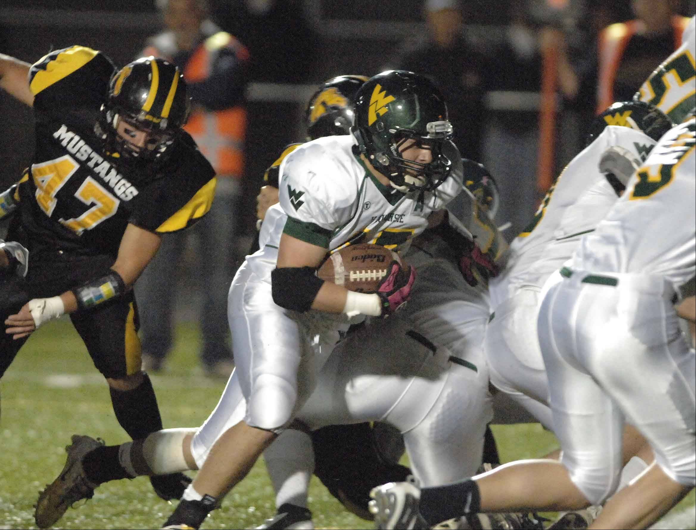 Waubonsie Valley running back Austin Guido, center, committed to play football at Western Michigan.