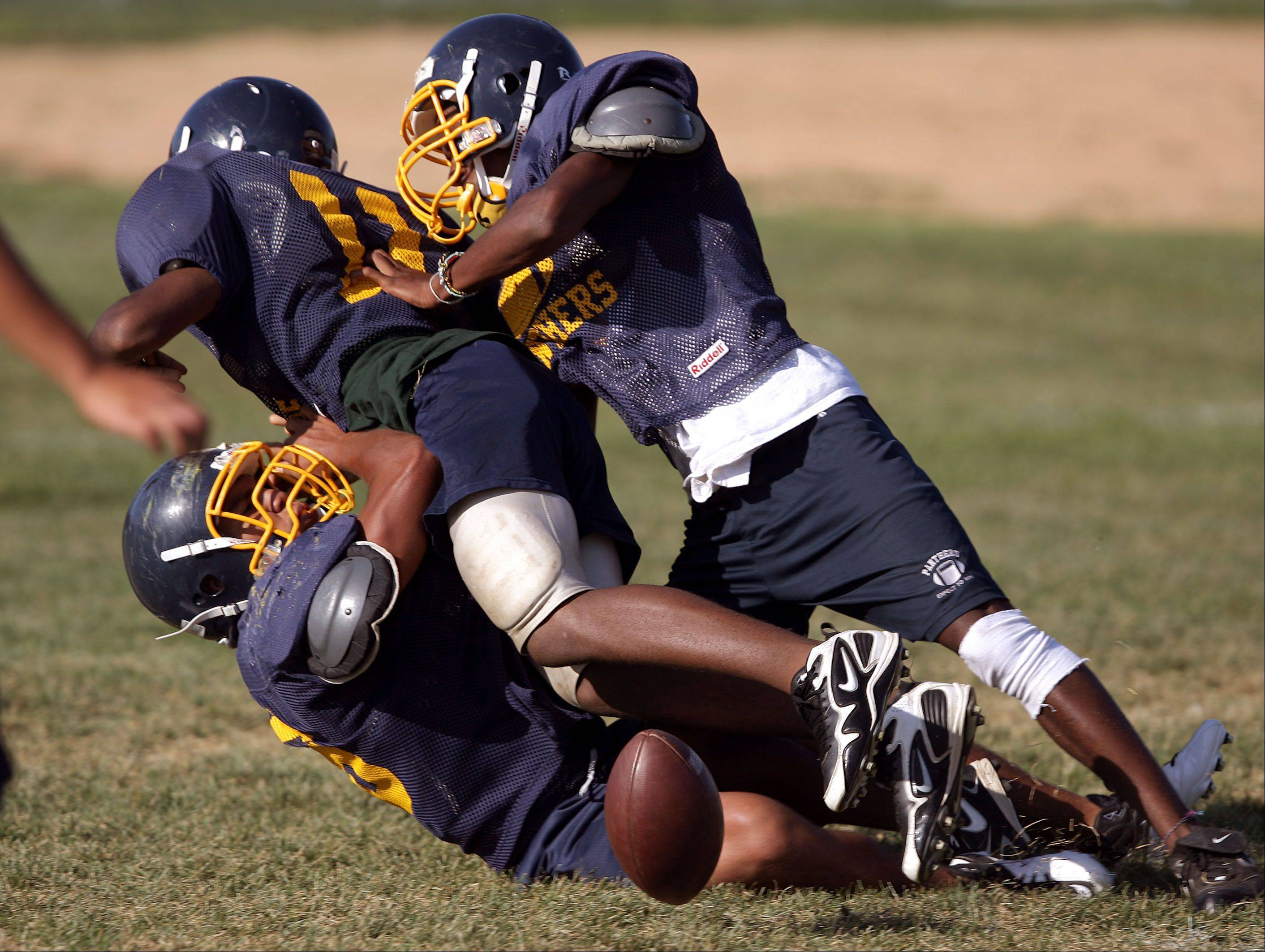 Should tackling be limited in youth, high school football practice?