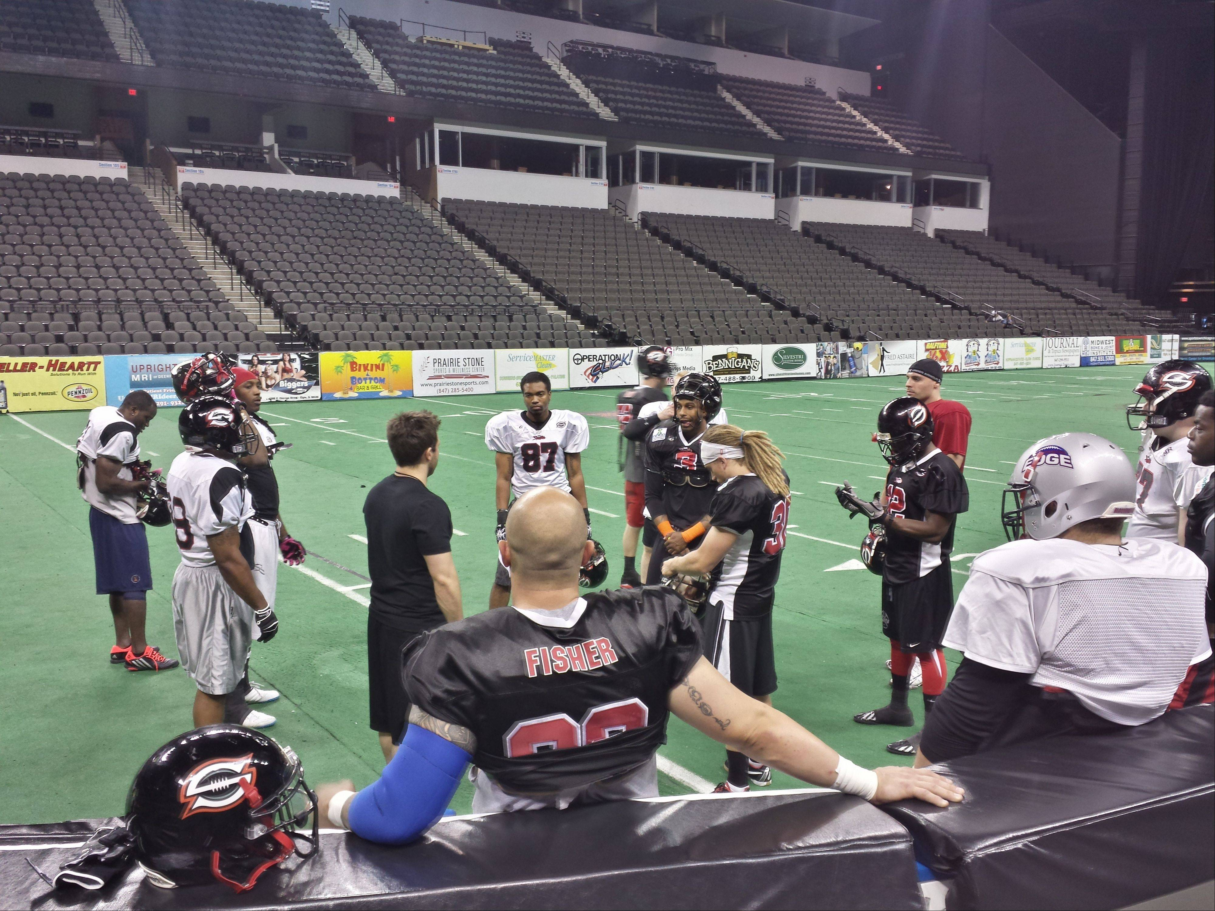 The Chicago Slaughter gathers to take in a pregame meeting with offensive coordinator Pat Pistorio before a game at the Sears Centre in May. Pistorio has been named head coach at South Elgin High School.