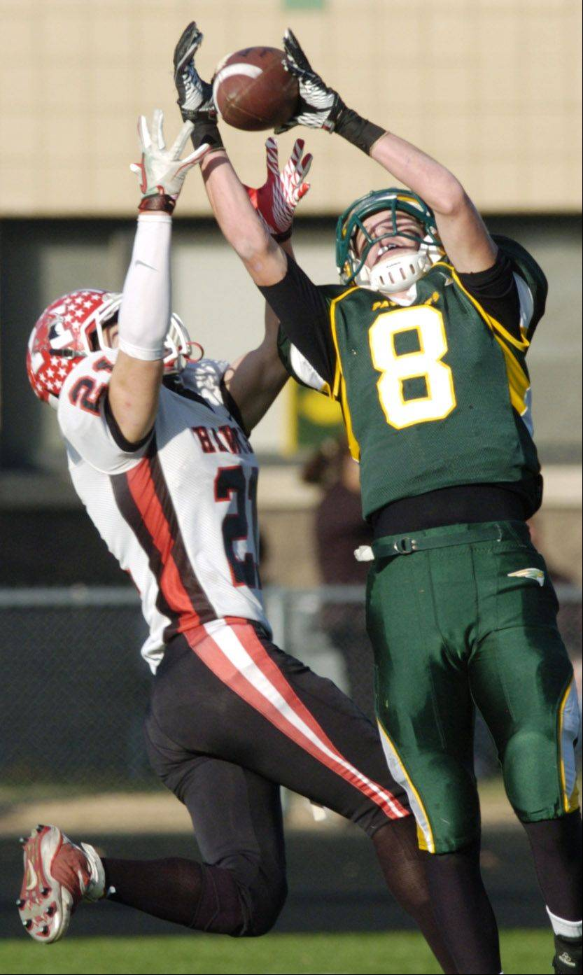 Stevenson's Matt Morrissey, right, makes a catch in front of Maine South's Danny Allegretti in the 2011 season. Morrissey recently committed to play football at Michigan State.