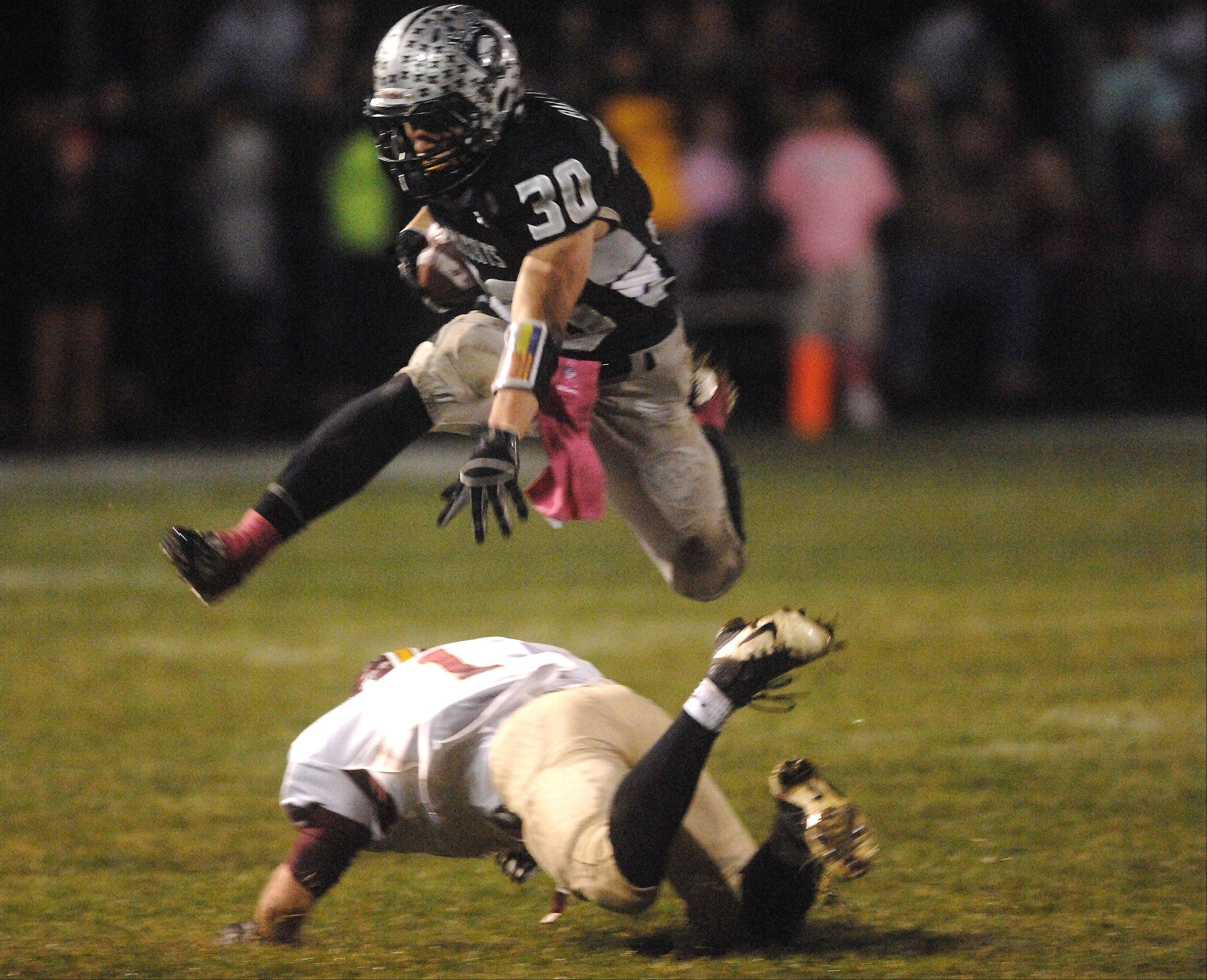 Jesse Balluff, pictured hurdling a would-be Morris tackler during last year's Northern Illinois Big XII East Conference-clinching 33-30 win, will be one of the key players on a Kaneland team that enters the season on a 28-game regular season winning streak.
