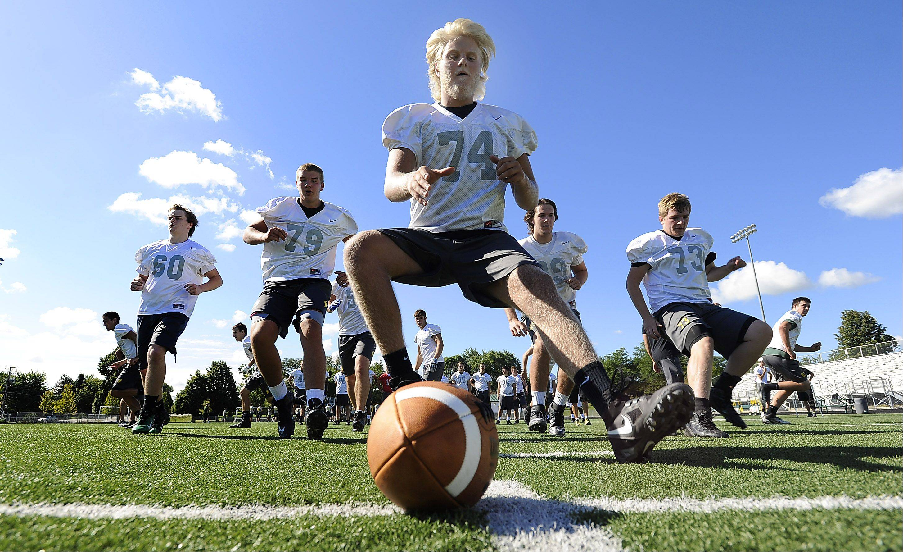 Fremd football player Jack Albrecht prepares to snap the ball at Fremd High School on this first day of practice.