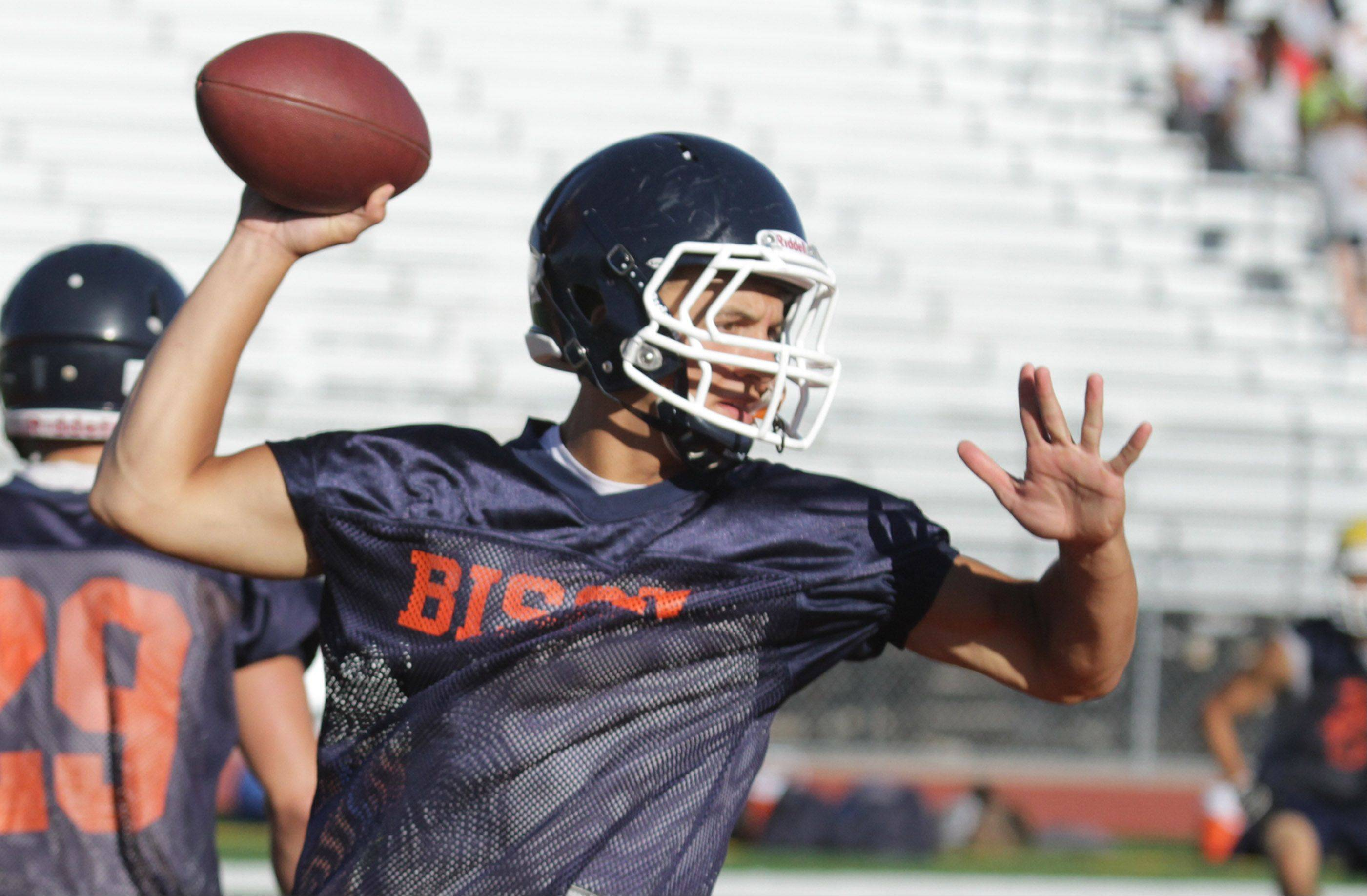 Buffalo Grove High School starting quarterback Andrew Apel passes the during the first day of practice on Wednesday, August 14, 2013.