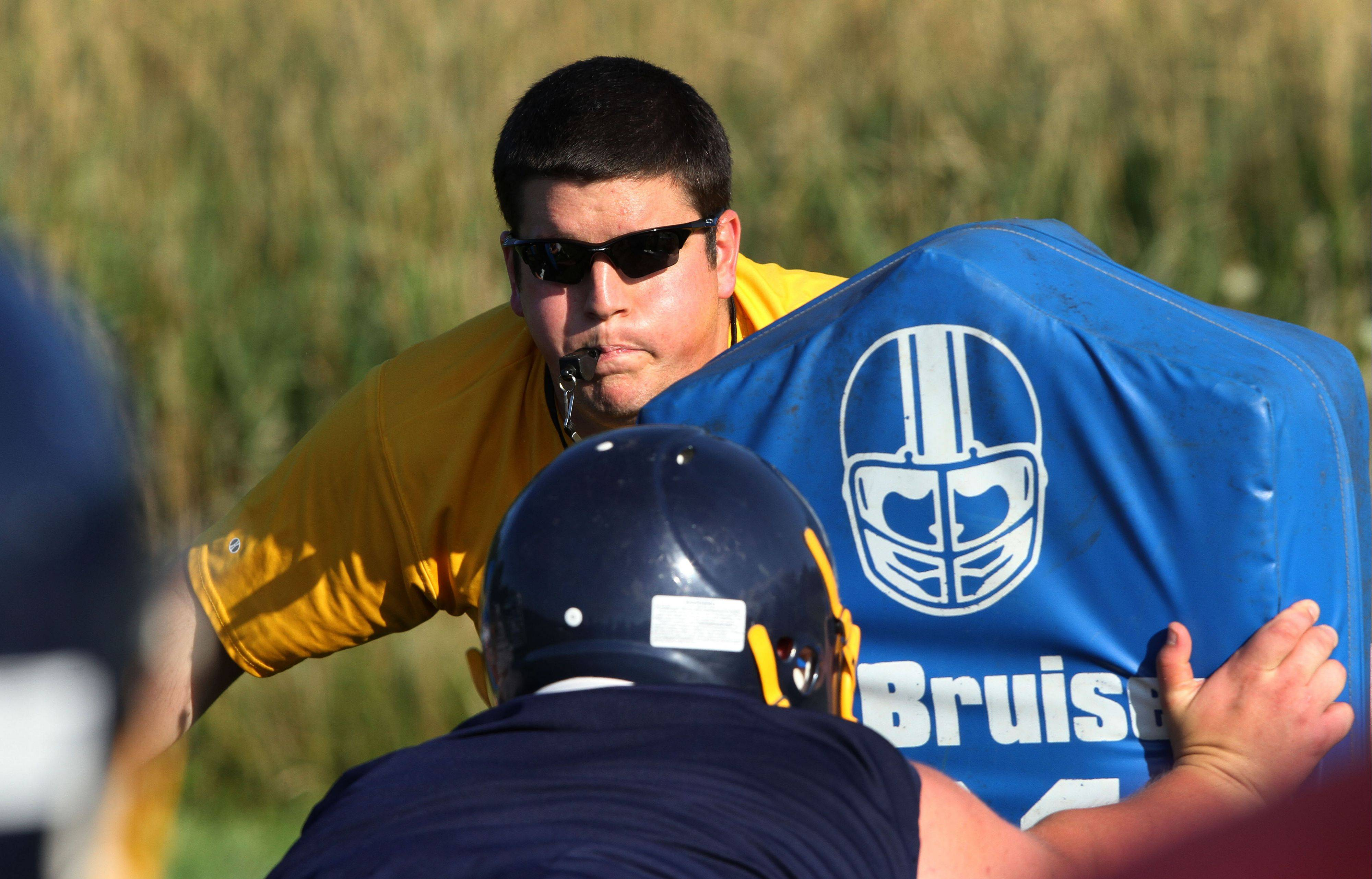 New coach Jordan Eder leads his players during the first day of football practice Wednesday at Round Lake High School.