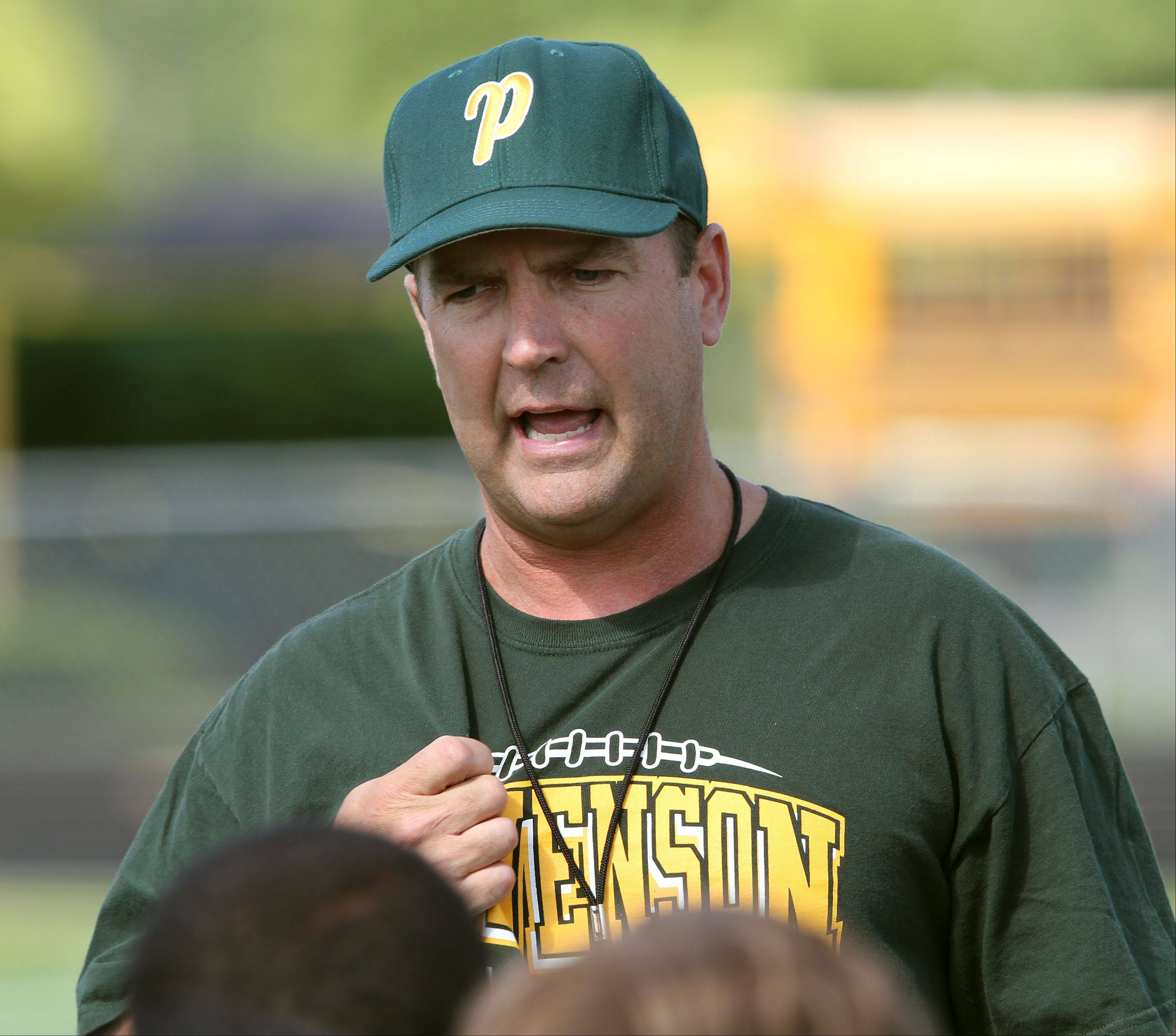 Head coach Bill McNamara talks with his players during the first day of football practice Wednesday at Stevenson High School.