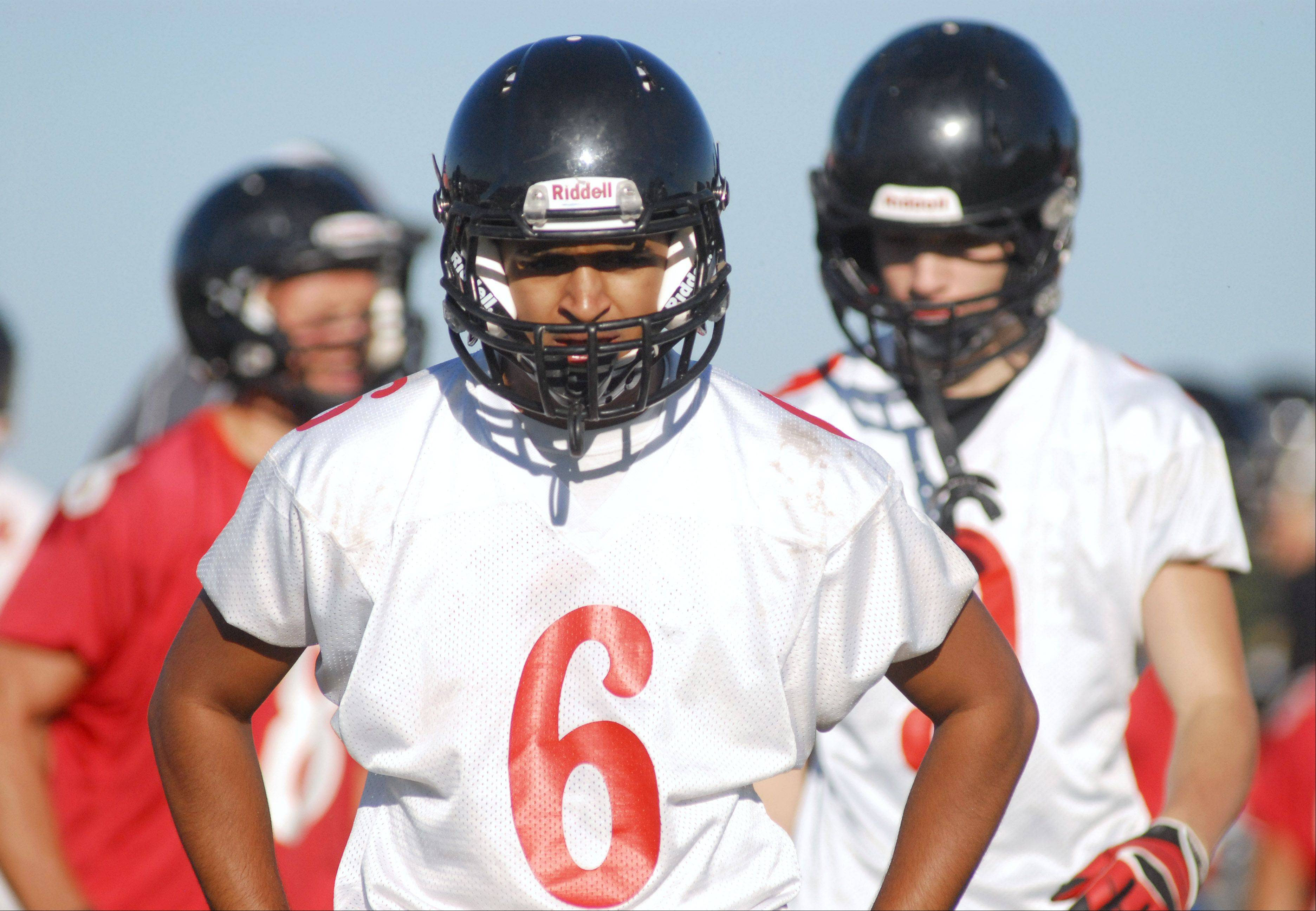 Senior Dallin Patel during varsity football's first day of practice at Huntley High School on Wednesday, August 14.
