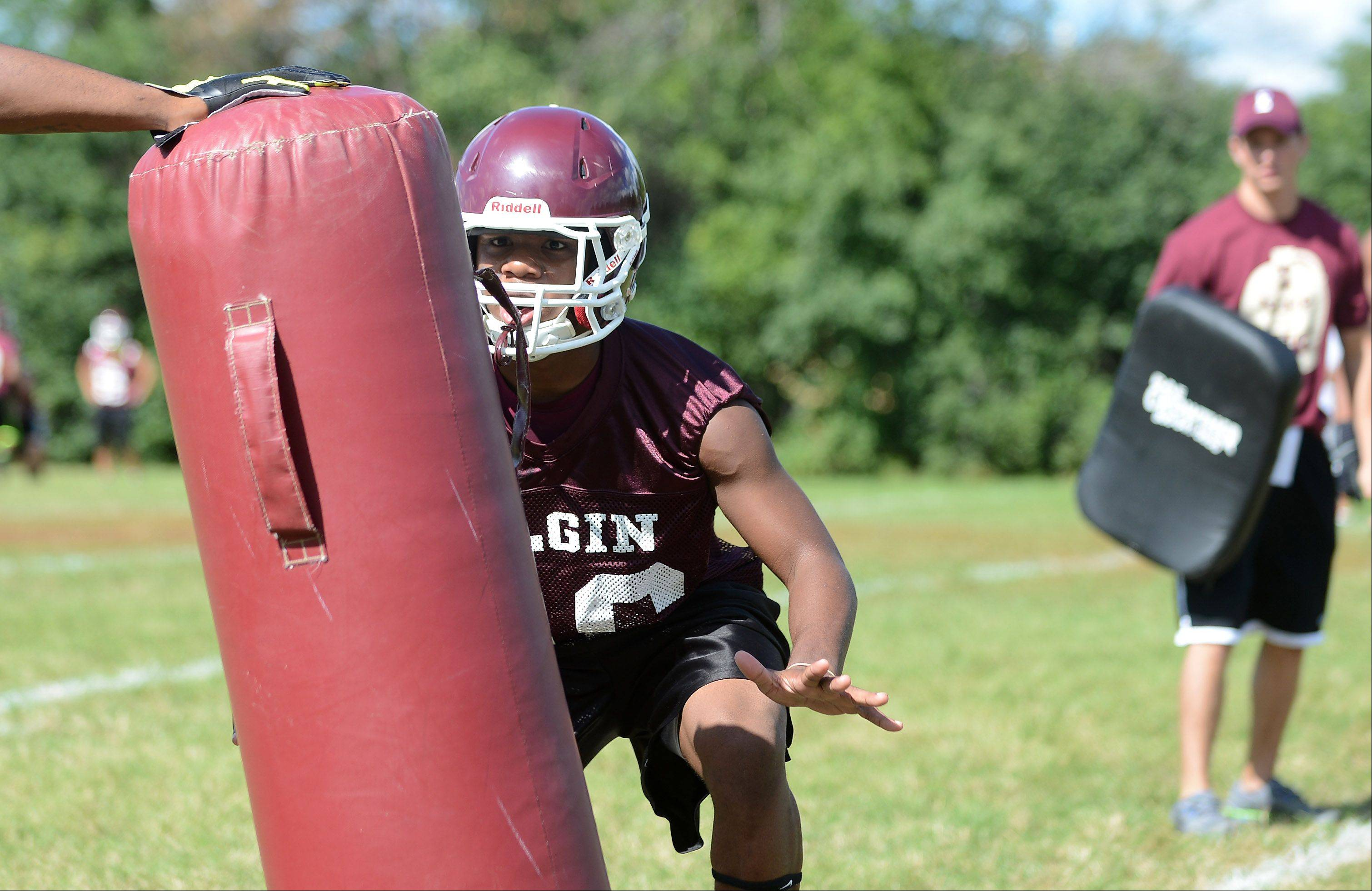 Trae Sallis gets ready to hit the pad during the first day of fall football practice at Elgin High School Wednesday.