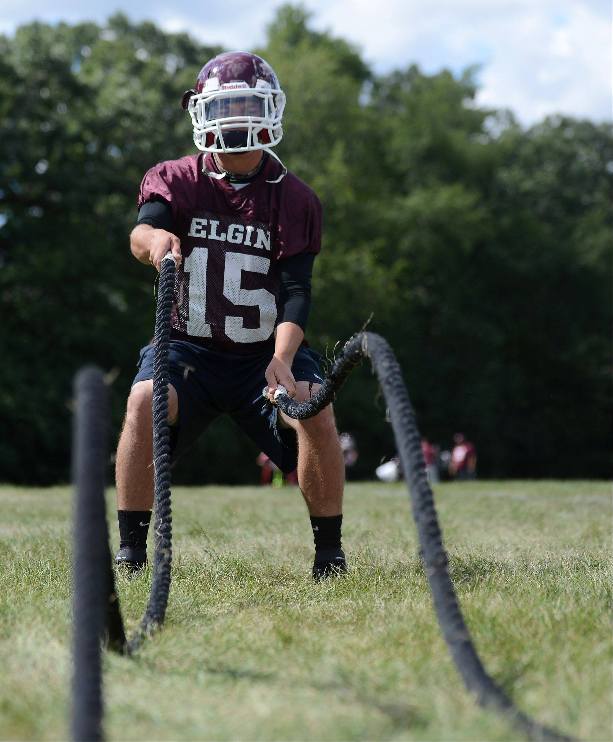 Senior quarterback Ryan Sitter works out during the first day of fall football practice at Elgin High School Wednesday.