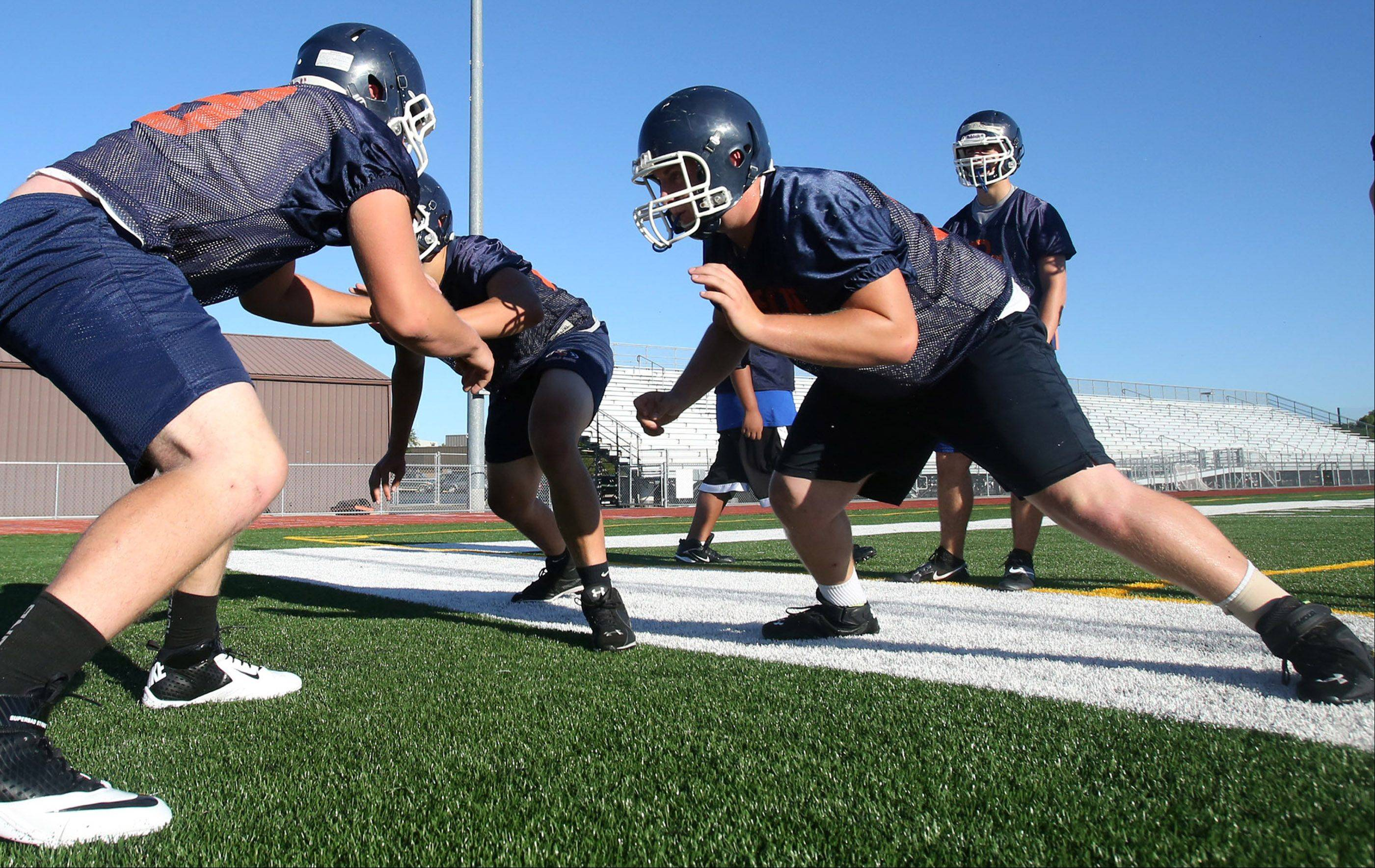Aaron Schubert, right, in drills against defensive players at Buffalo Grove.