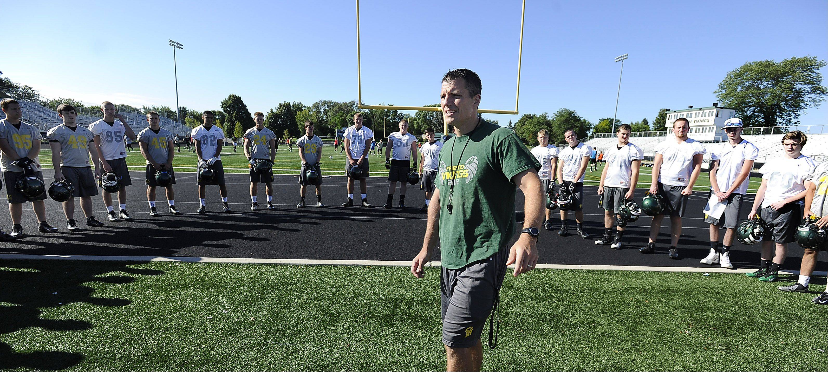 Fremd football coach Lou Sponsel reviews his players.