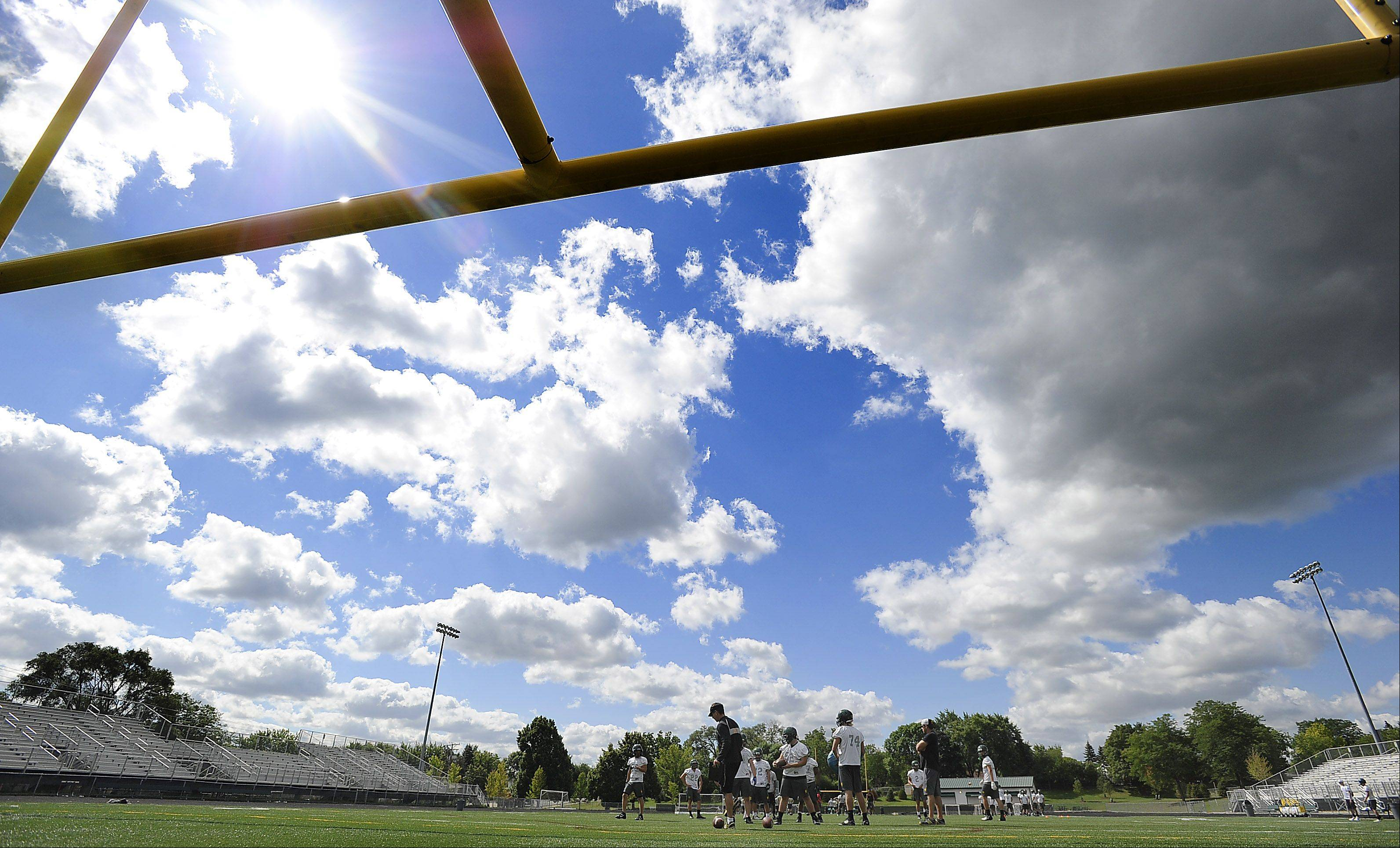 The sun shines brightly on the first day of football practice at Fremd High School.