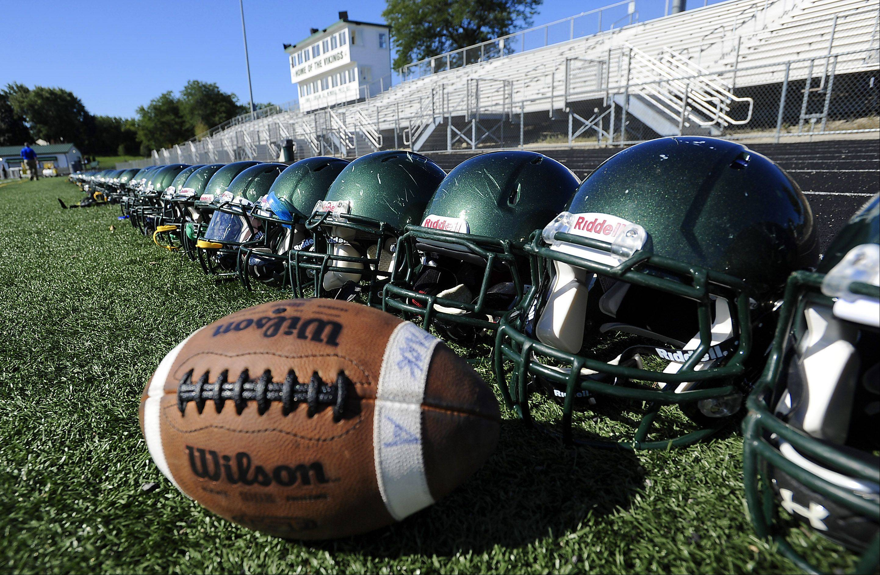 Fremd's football helmets line the field .