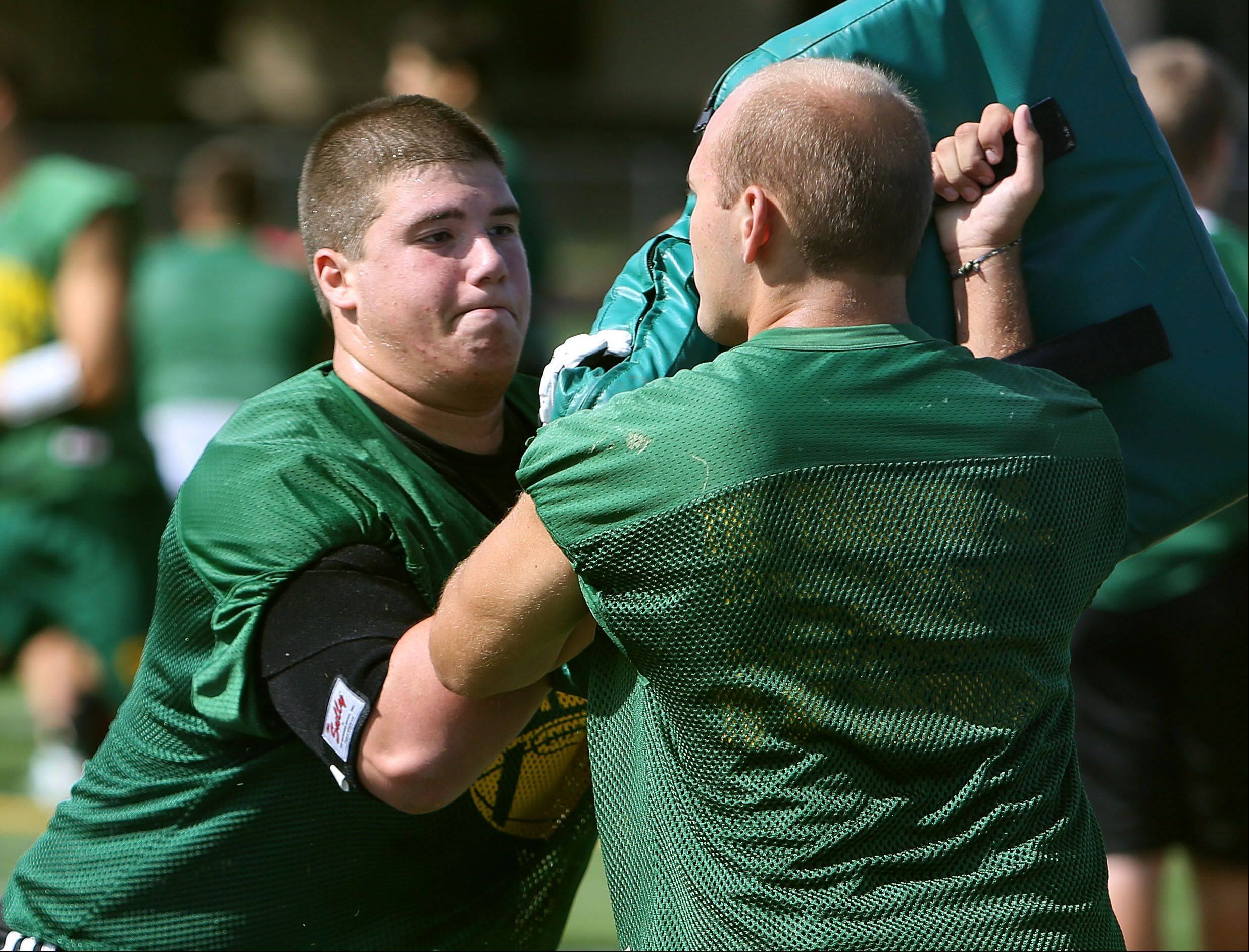 Offensive tackle Zach Novodelsky, left, blocks at Stevenson High School.