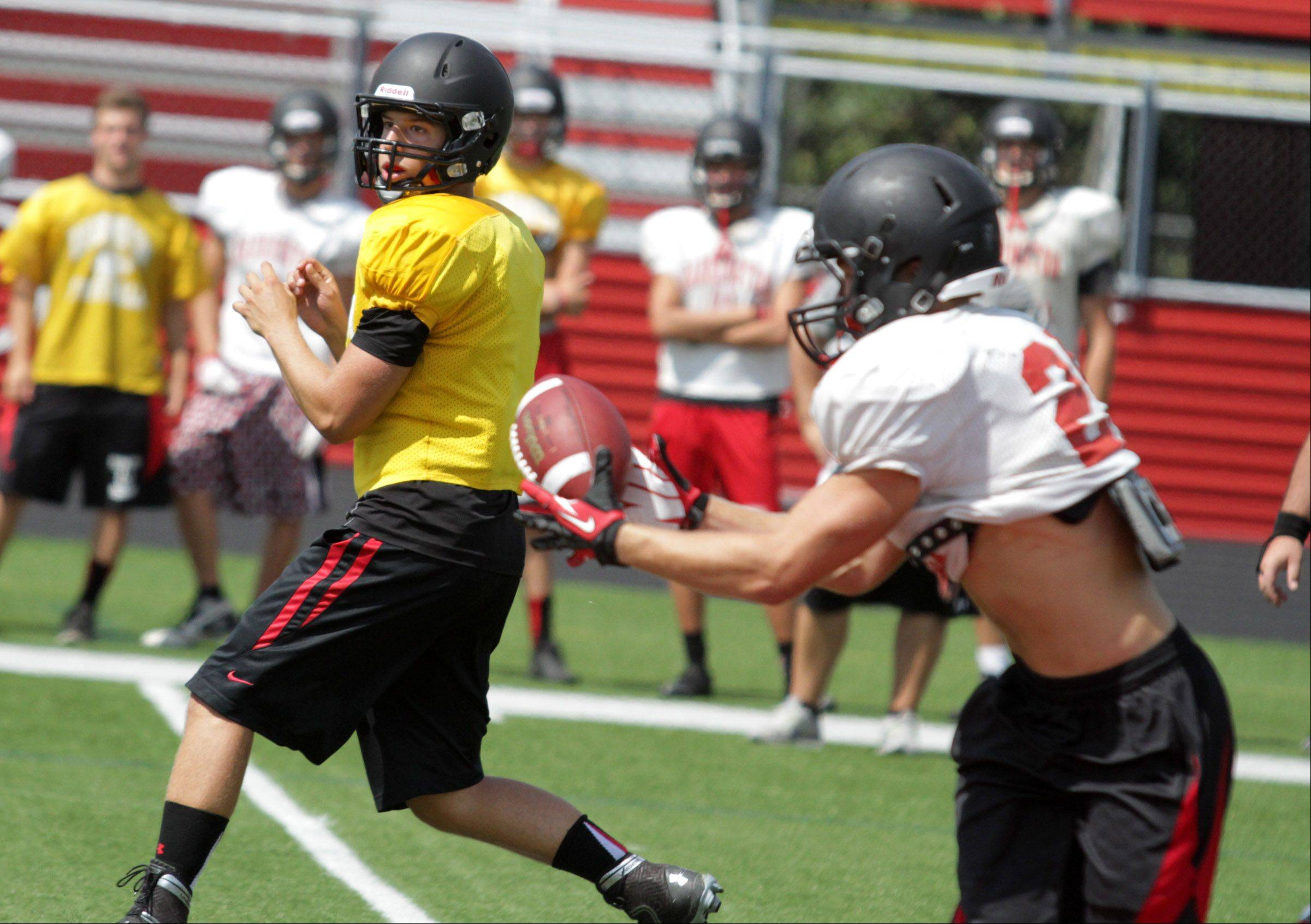 Barrington quarterback Daniel Kubiuk pitches out to running back Dylan Abel during preseason practice.