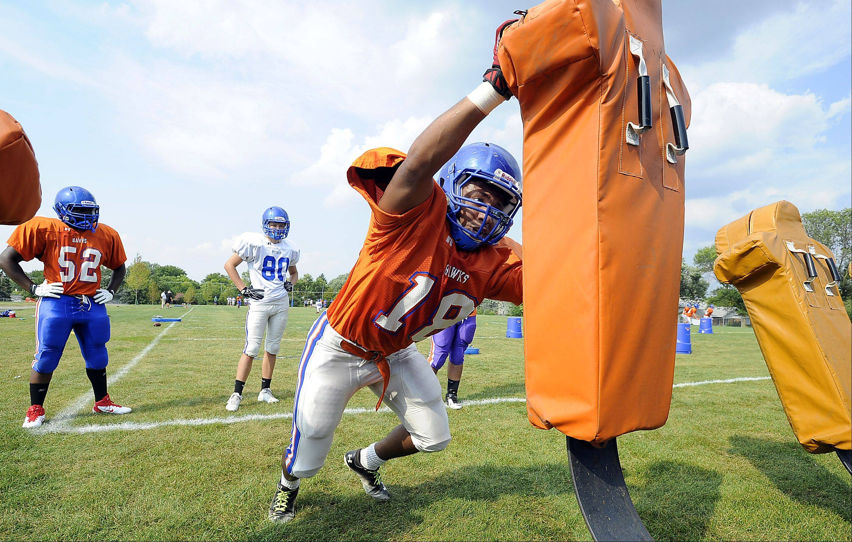 Hoffman Estates Tylic Grace gives his best effort during football practice.