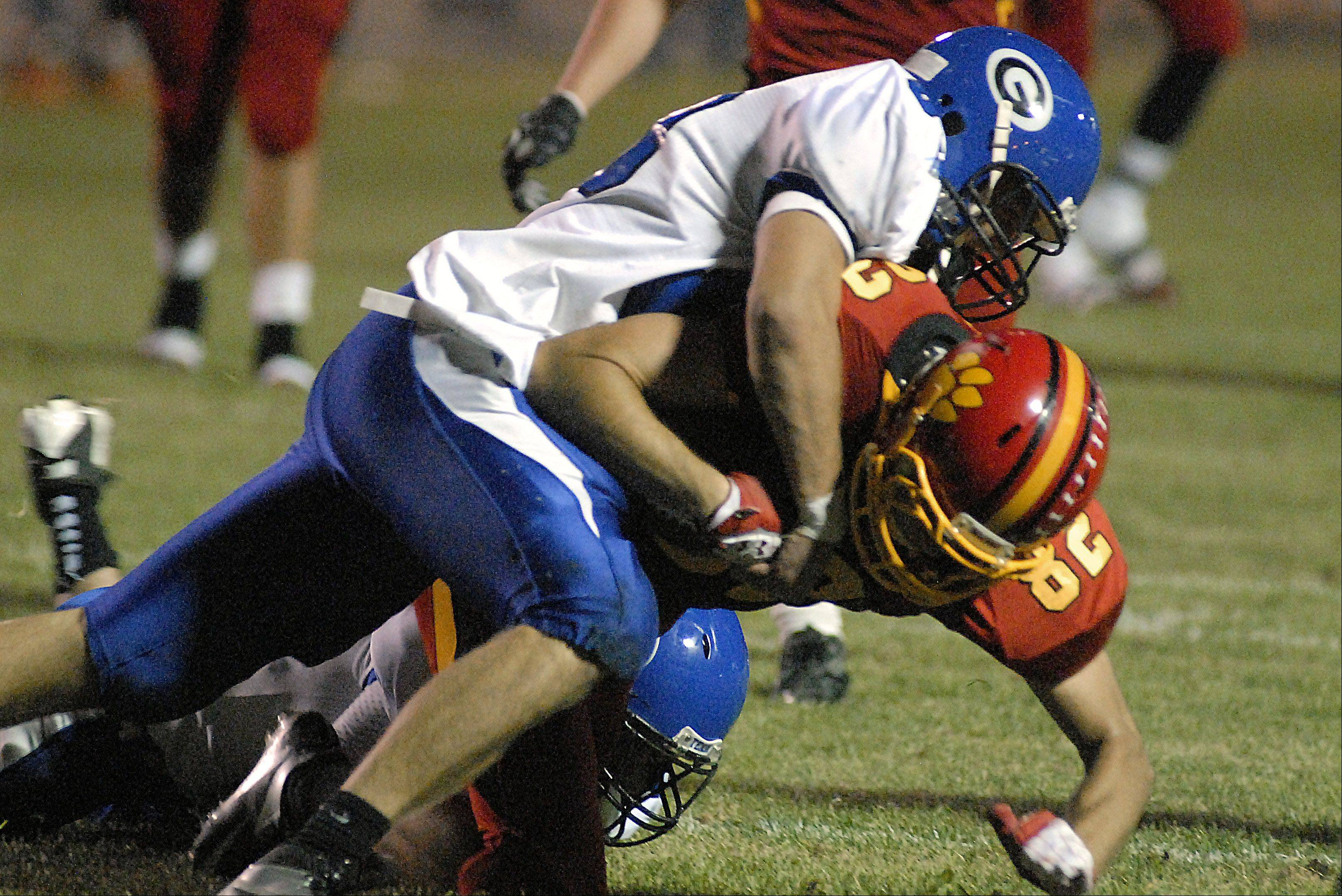 Laura Stoecker/lstoecker@dailyherald.com � Geneva's Billy Douds takes down Batavia's Zachary Strittmatter in the second quarter on Friday, September 7.