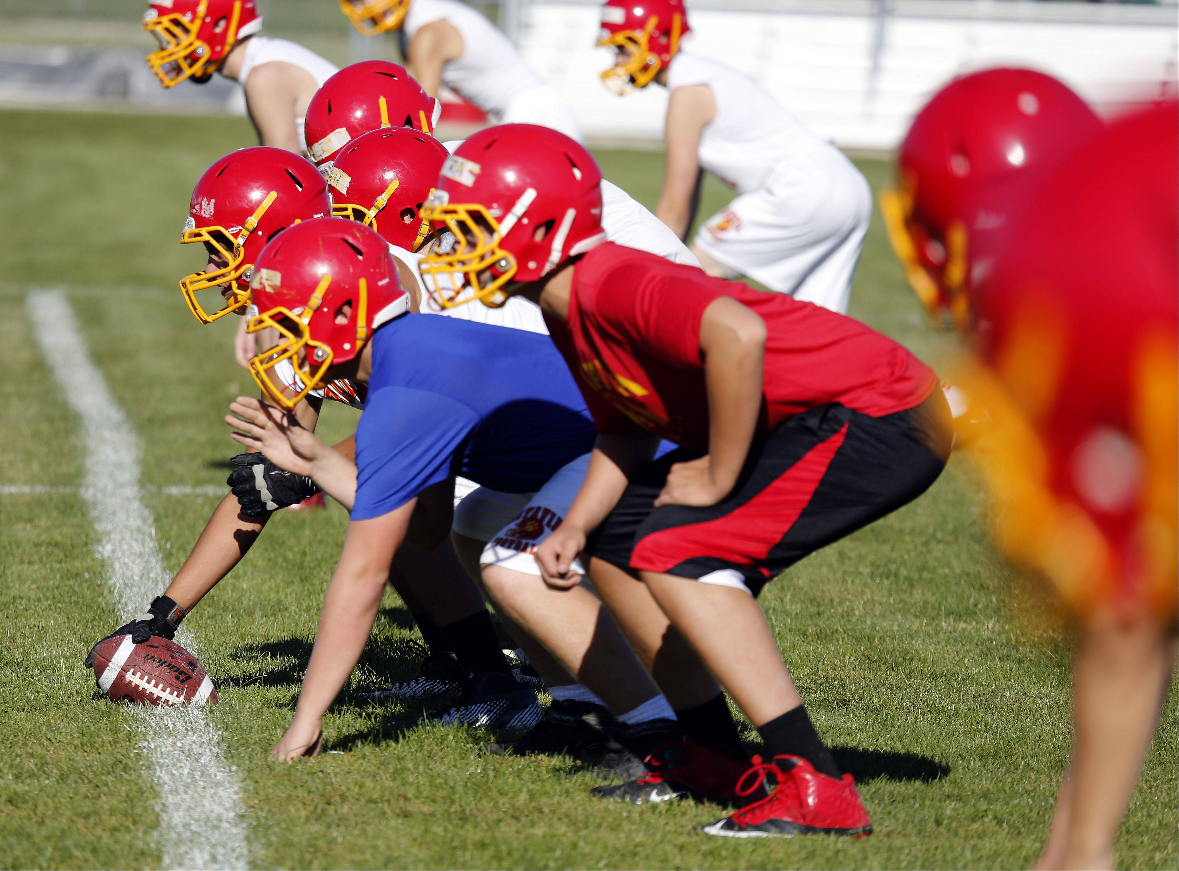 Brian Hill/bhill@dailyherald.comThe offense lines up during the first day of football practice at Batavia High School Wednesday.