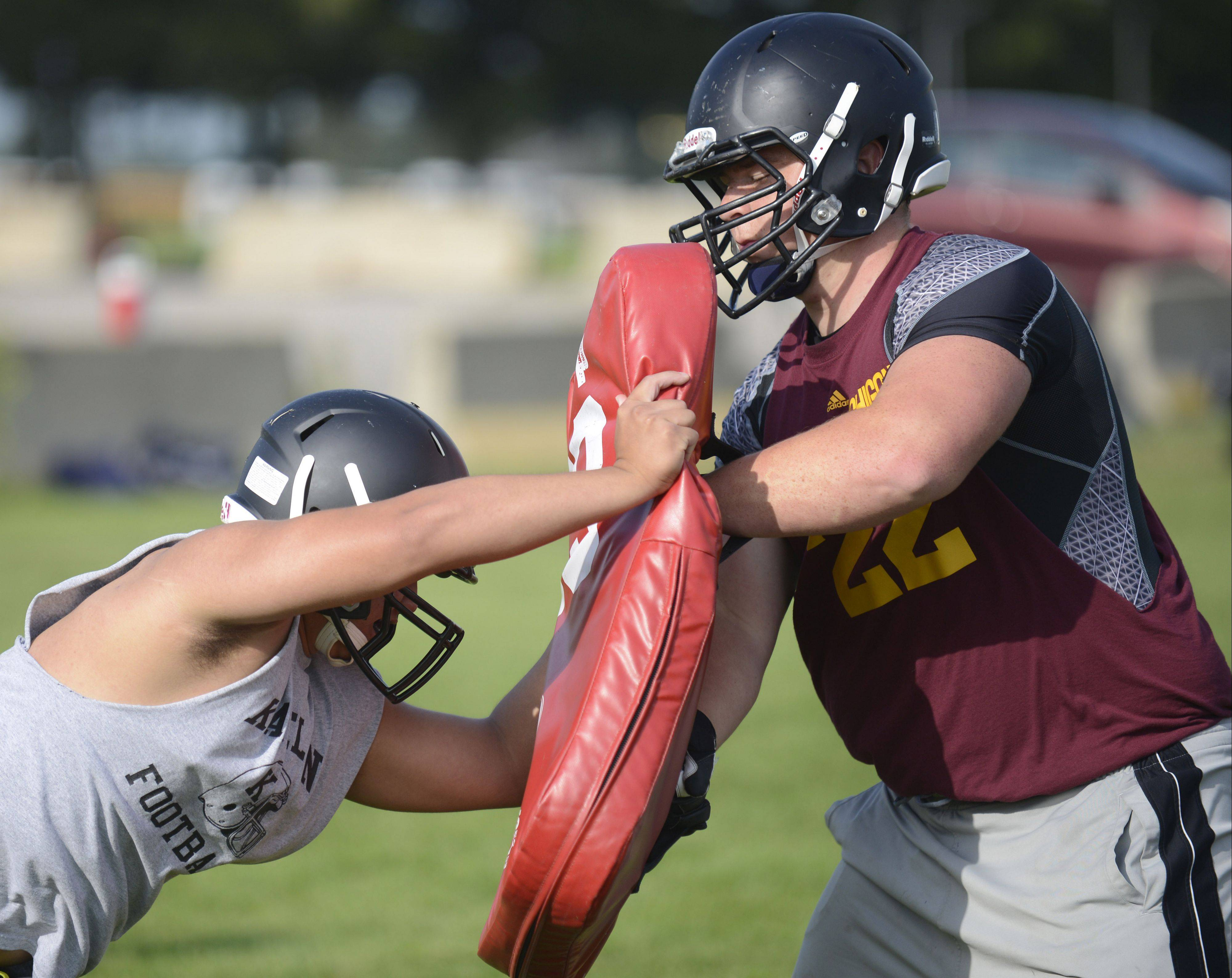 Bryan Endrenal, left, battles Joe Komel during a Kaneland practice on Aug. 15. Komel is part of an experienced offensive line.