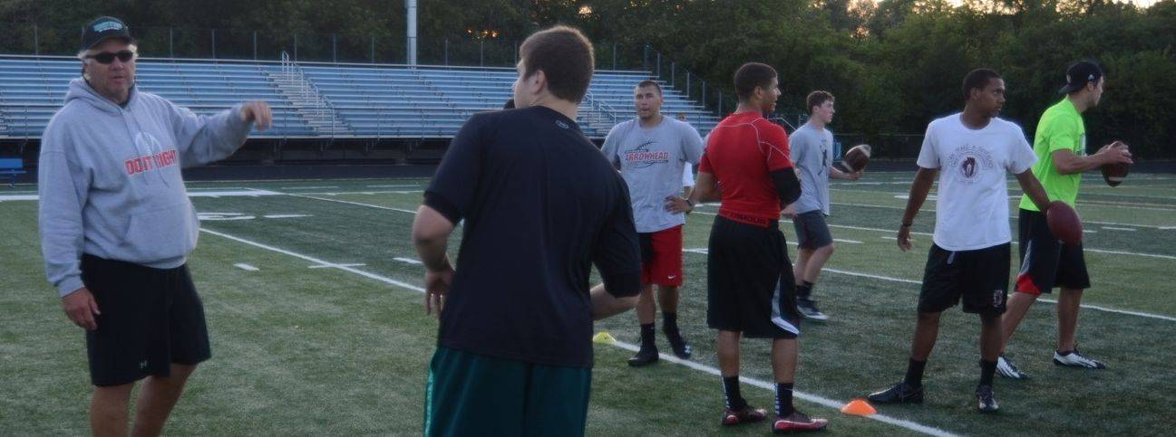 He was part of the 1983 NFL draft class, but now Jeff Christensen, left, is helping others chase their quarterback dreams. Here he's shown working with a group of high school and college quarterbacks from the Chicago and Indiana regions.