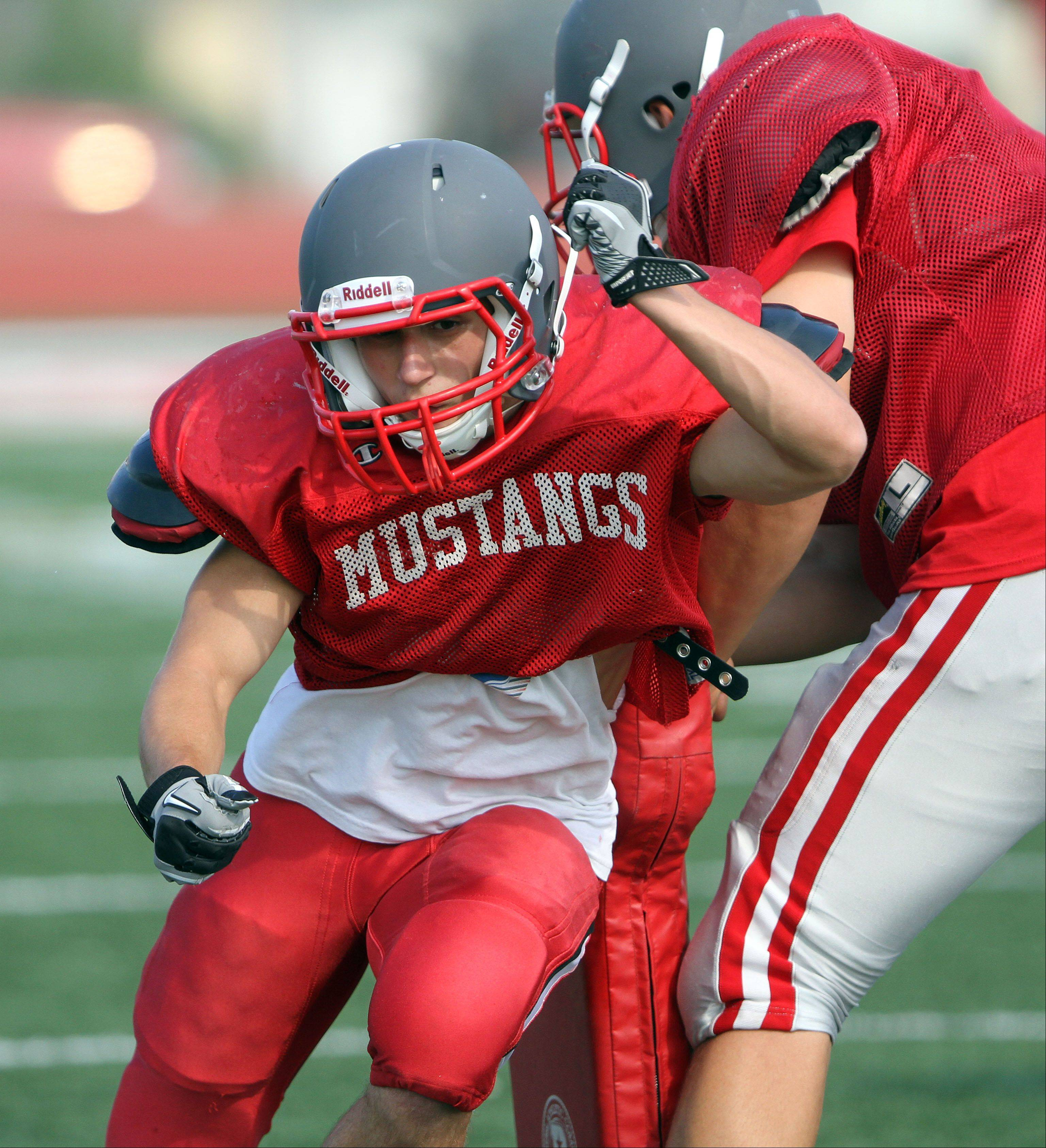 Matt Hutchison runs through drills during football practice at Mundelein.