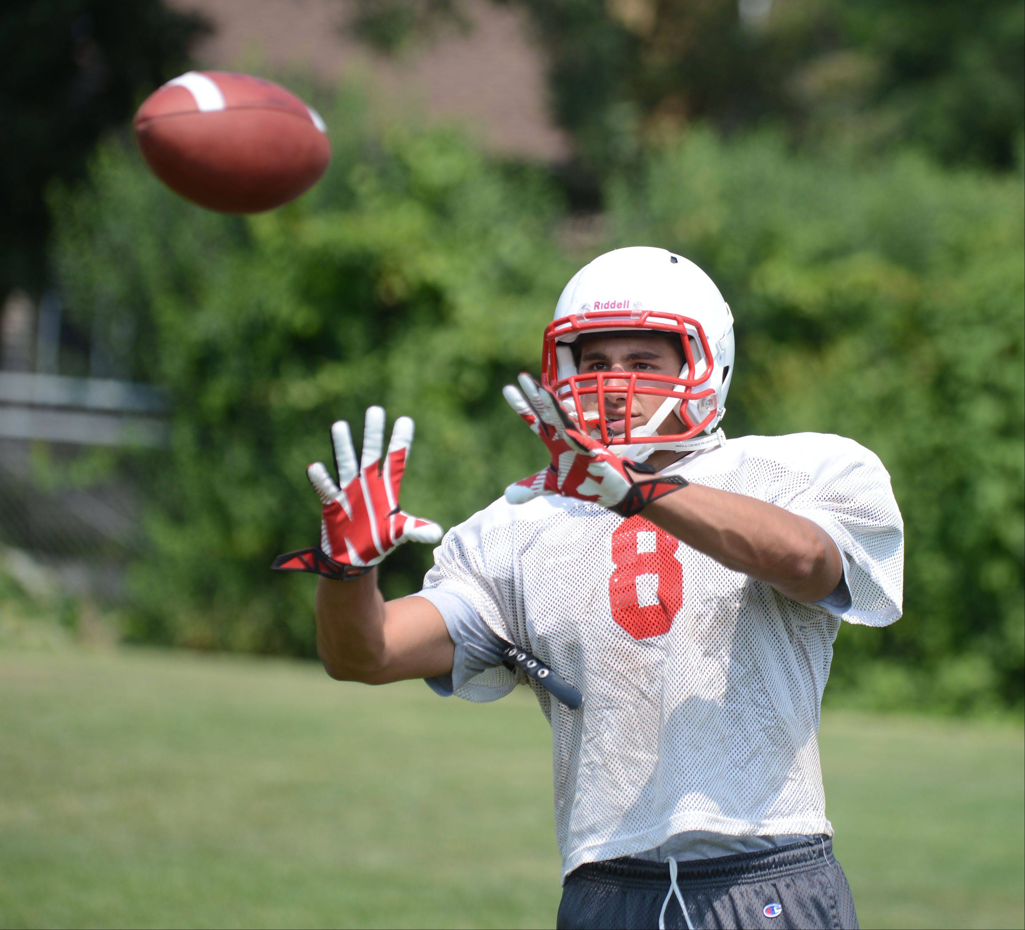 Nick Surges lines up a catch during Saturdays practice at Benet in Lisle.