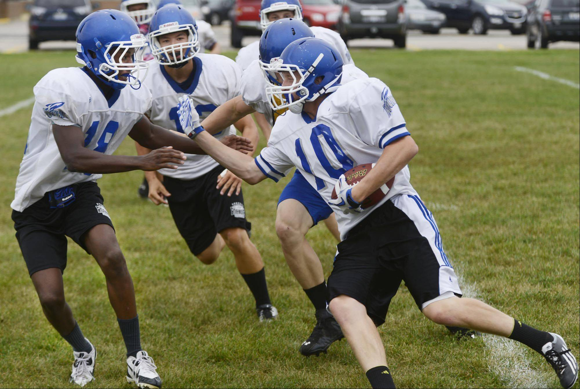 A.J. Fisher runs the ball at a Burlington Central football practice.