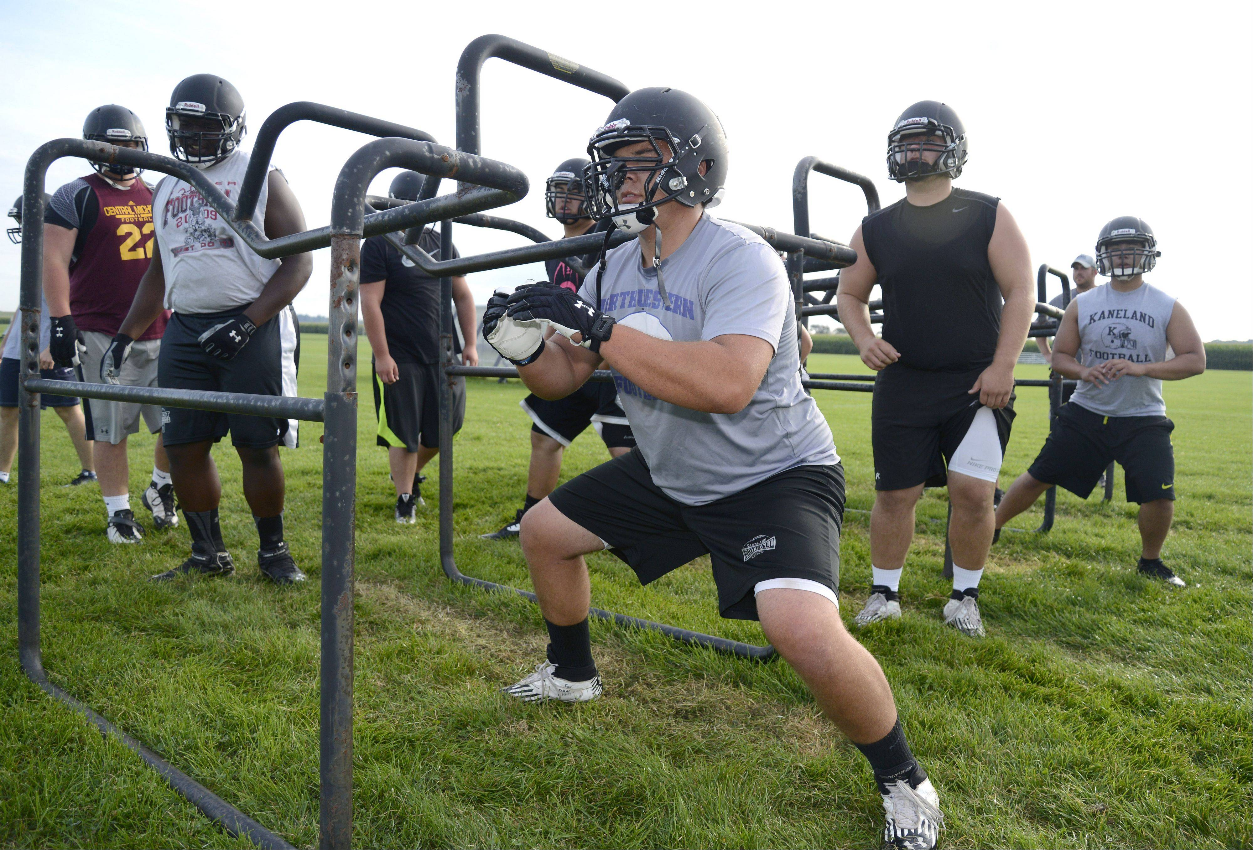 Laura Stoecker/lstoecker@dailyherald.com Senior Shane Jorgensen during drills at Kaneland High School's varsity football practice on Thursday, August 15.