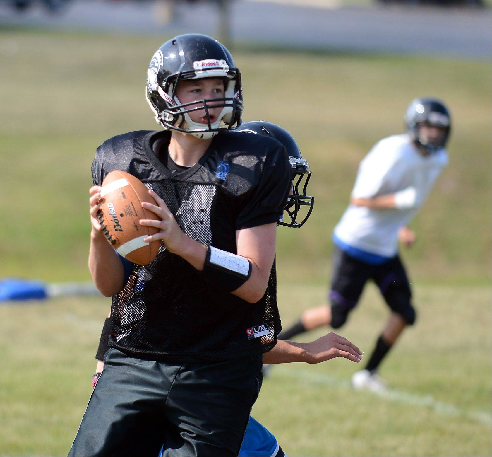 Quarterback Max Tucker looks for a target during Westminster Christian football practice. The Warriors play the first varsity game in school history Saturday in Chicago against Luther North.