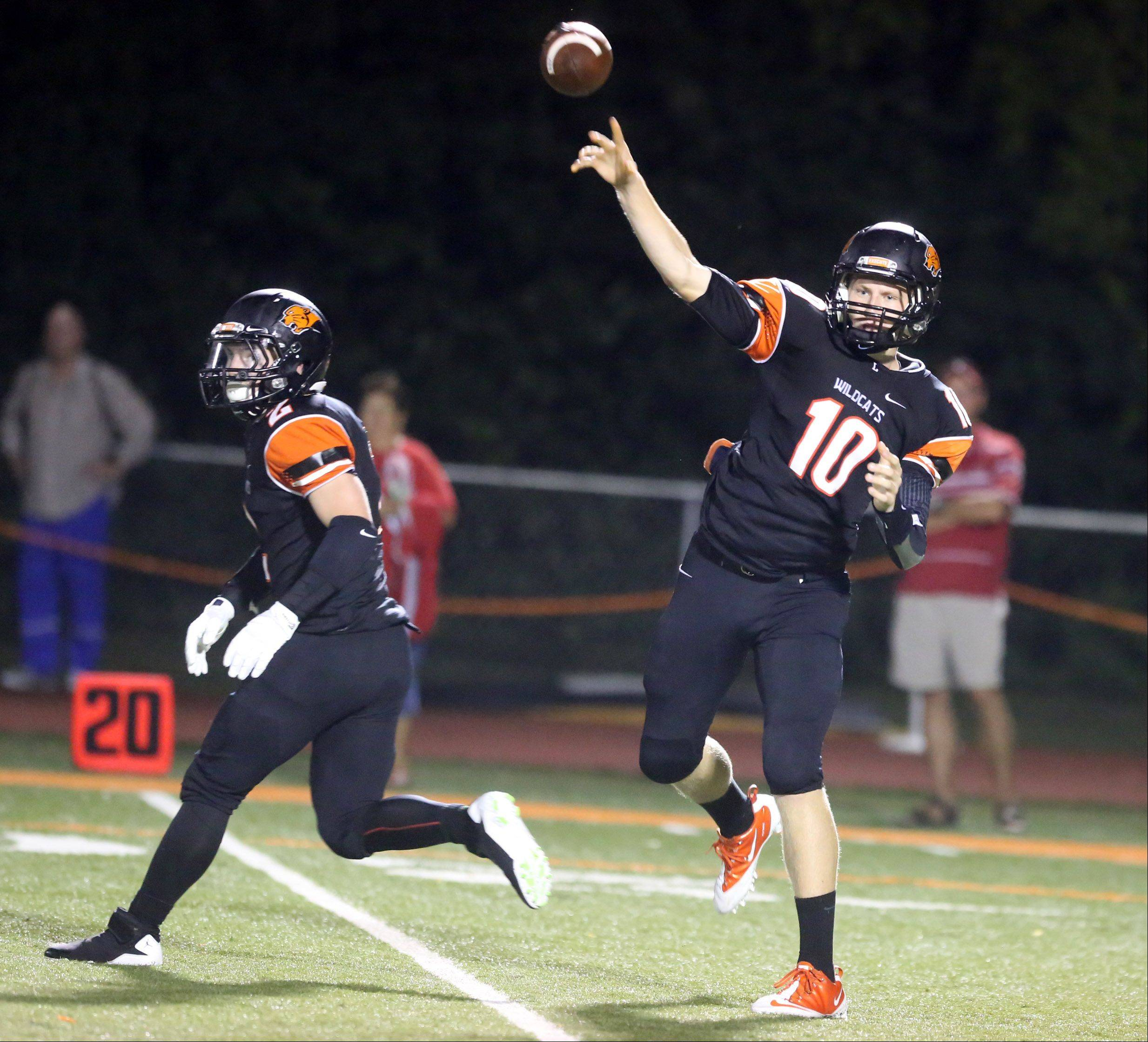 Libertyville quarterback Anthony Monken throws the ball to receiver Sean Ferraro during the first half at Libertyville on Friday.