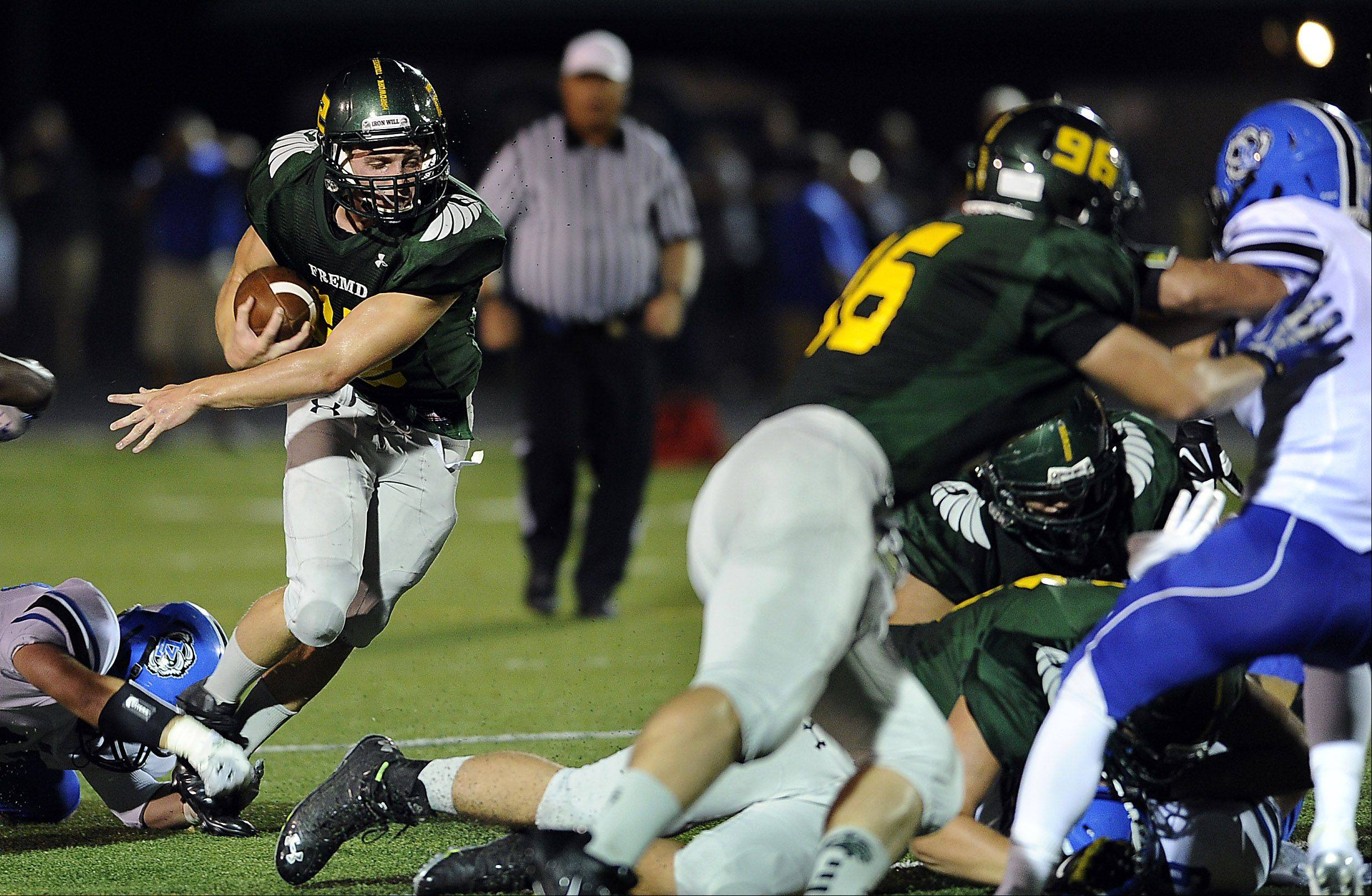 Fremd's Garrett Groot runs through Lake Zurich's defense in the first quarter.