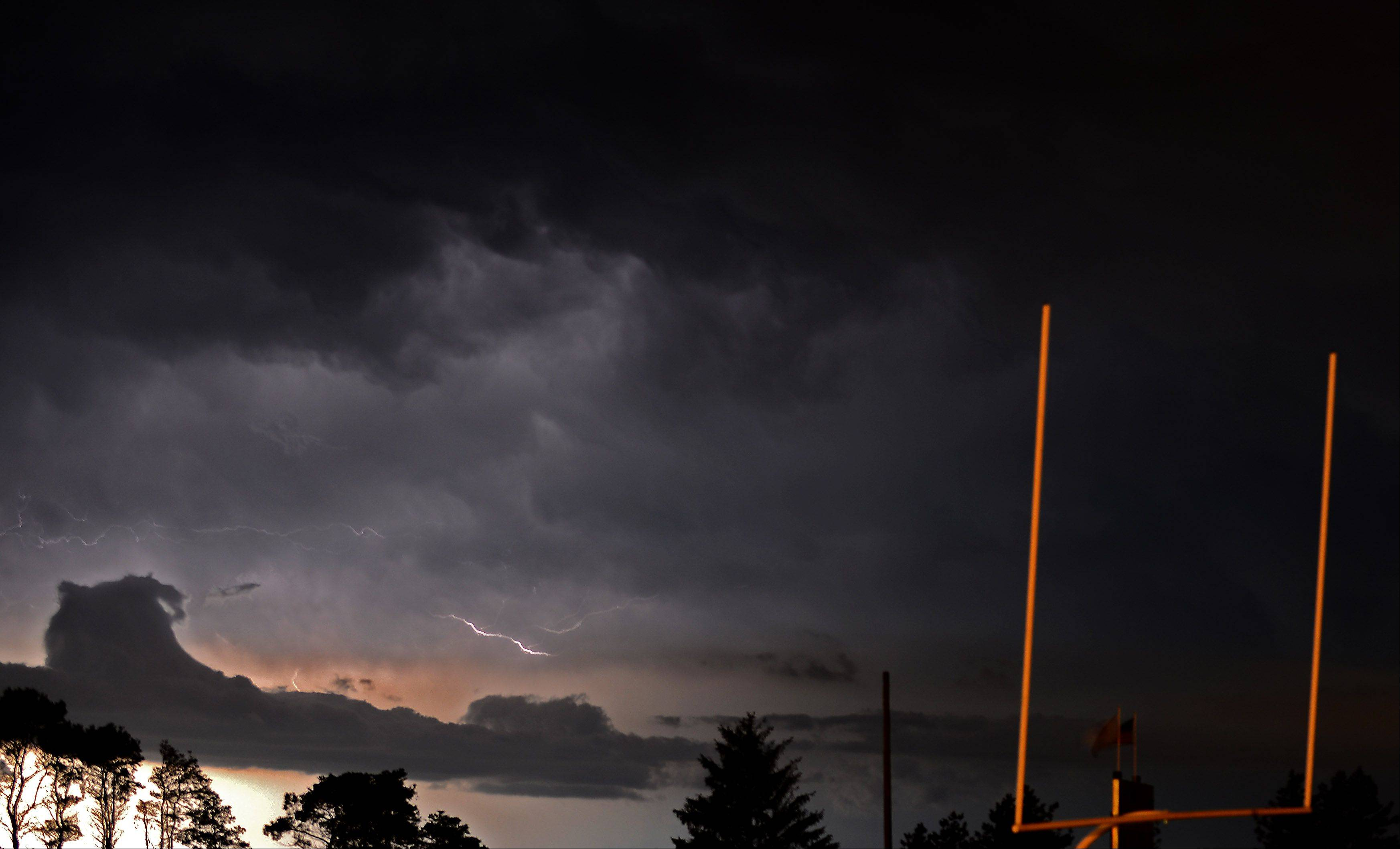 Bolts of lightning light up the night sky south and west of Burlington Central High School Friday.