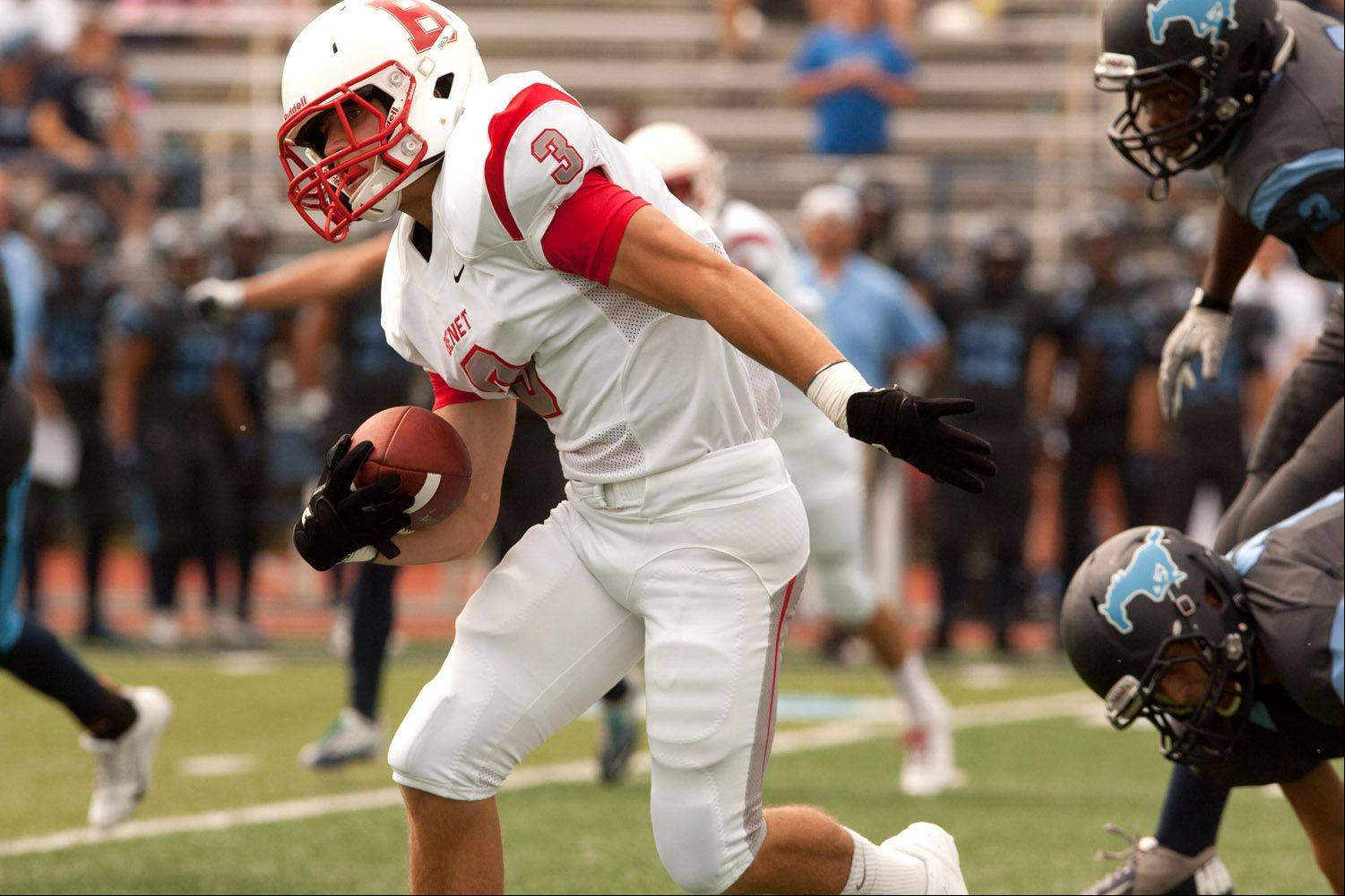 Benet Academy's Nick McTarnaghan gains yards against Downers Grove South during Saturday's season opener.