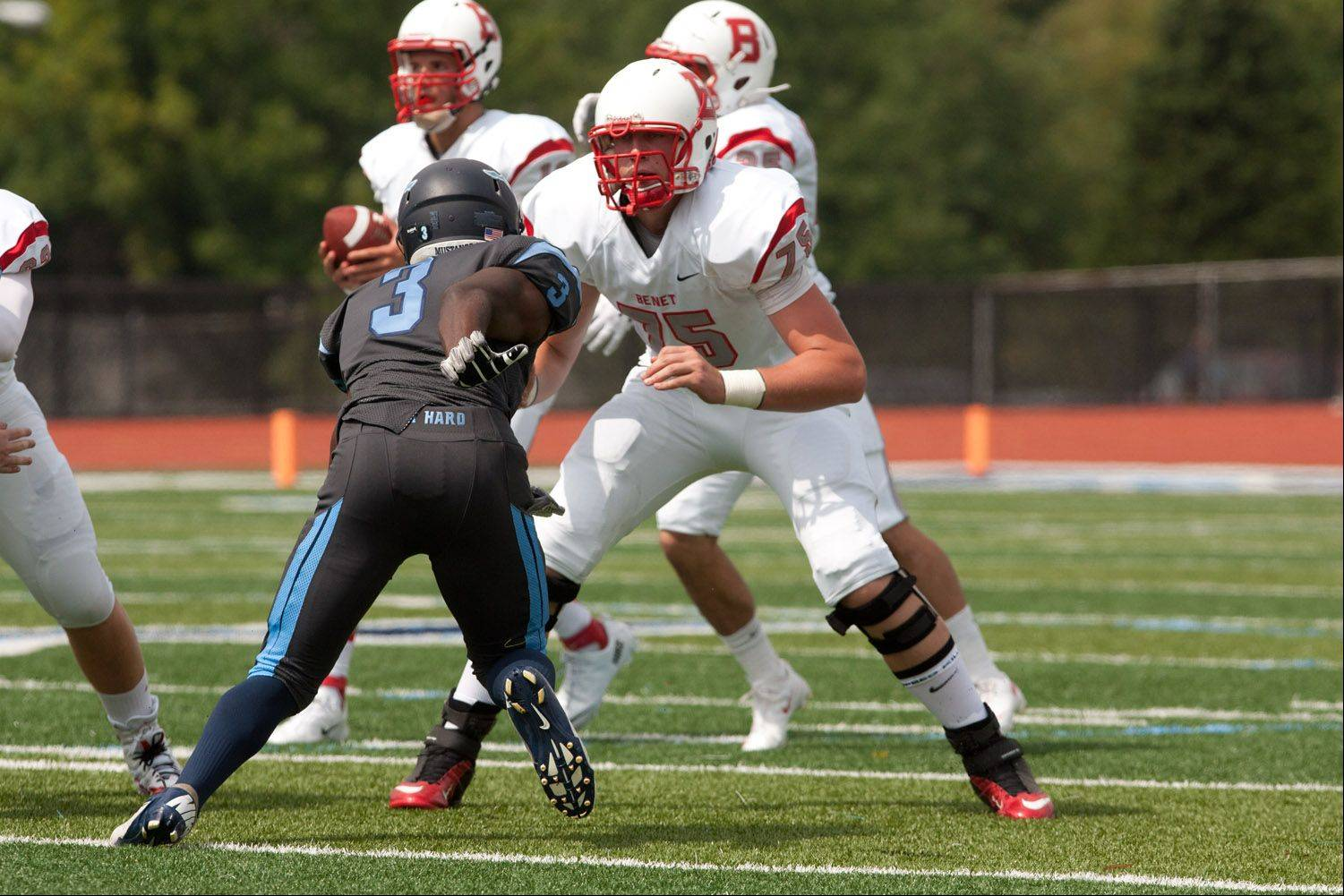 Benet Academy's Sean O'Mara defends against Downers Grove South's Idony Owens (3) during Saturday's season opener.