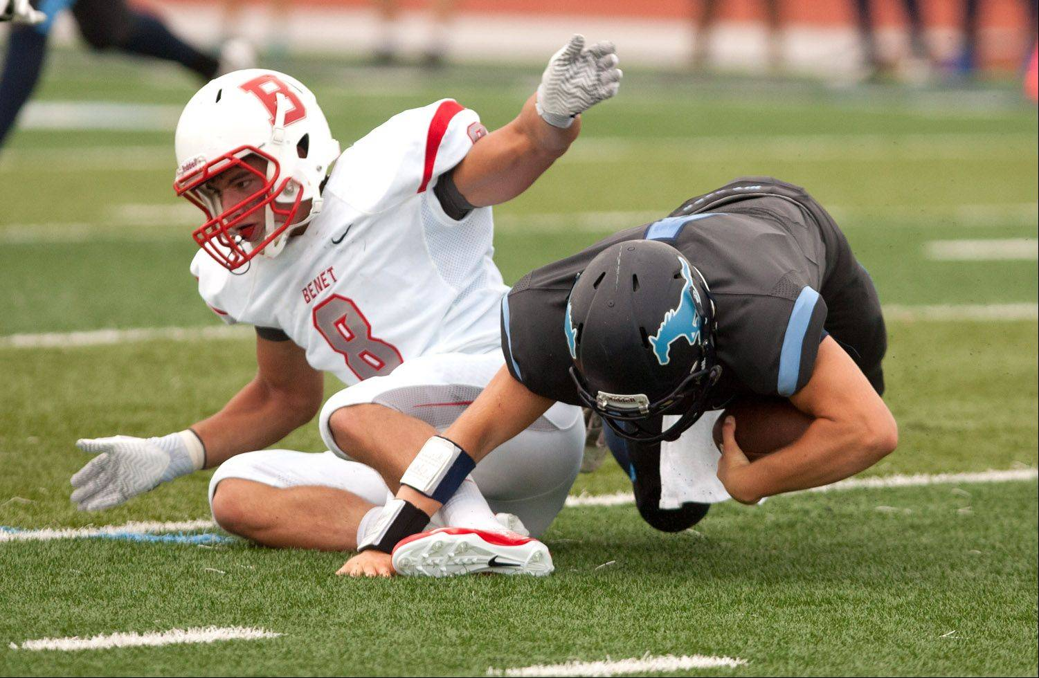 Benet Academy's Nick Surges, left, sacks Downers Grove South quarterback Jordan Skach during Saturday's season opener.