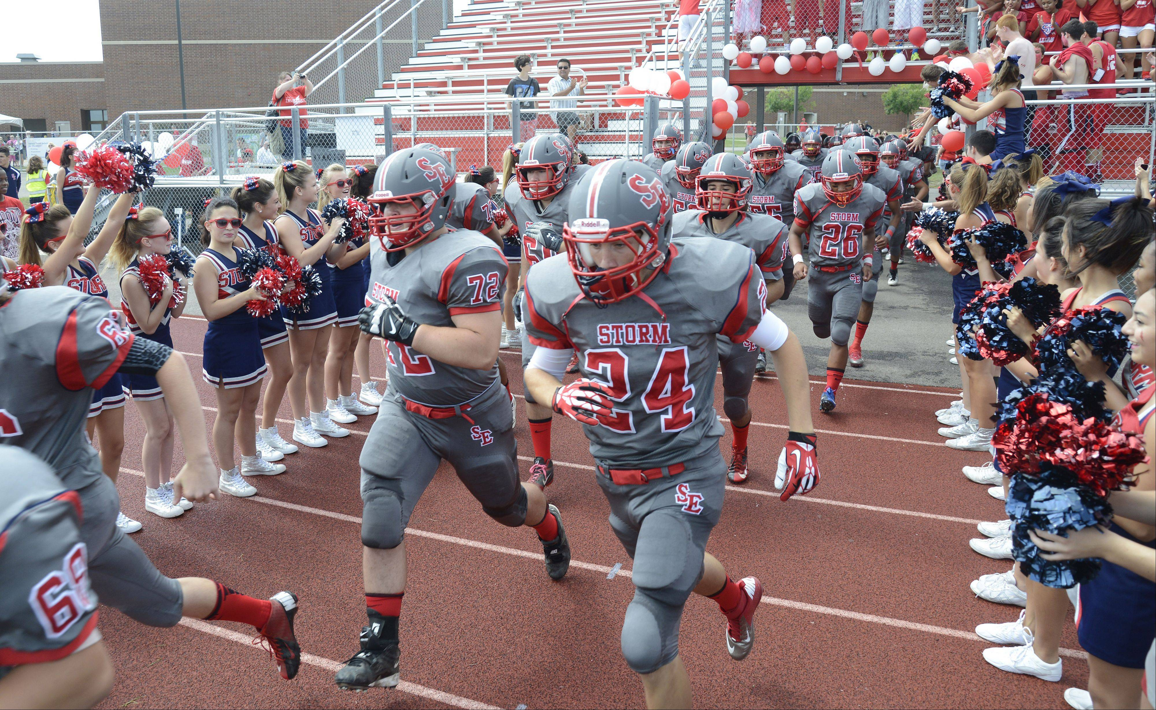 South Elgin seniors Alex Pierscionek, left, and Alec Barclay take to the field for the start of the game vs. St. Charles East on Saturday, August 31.