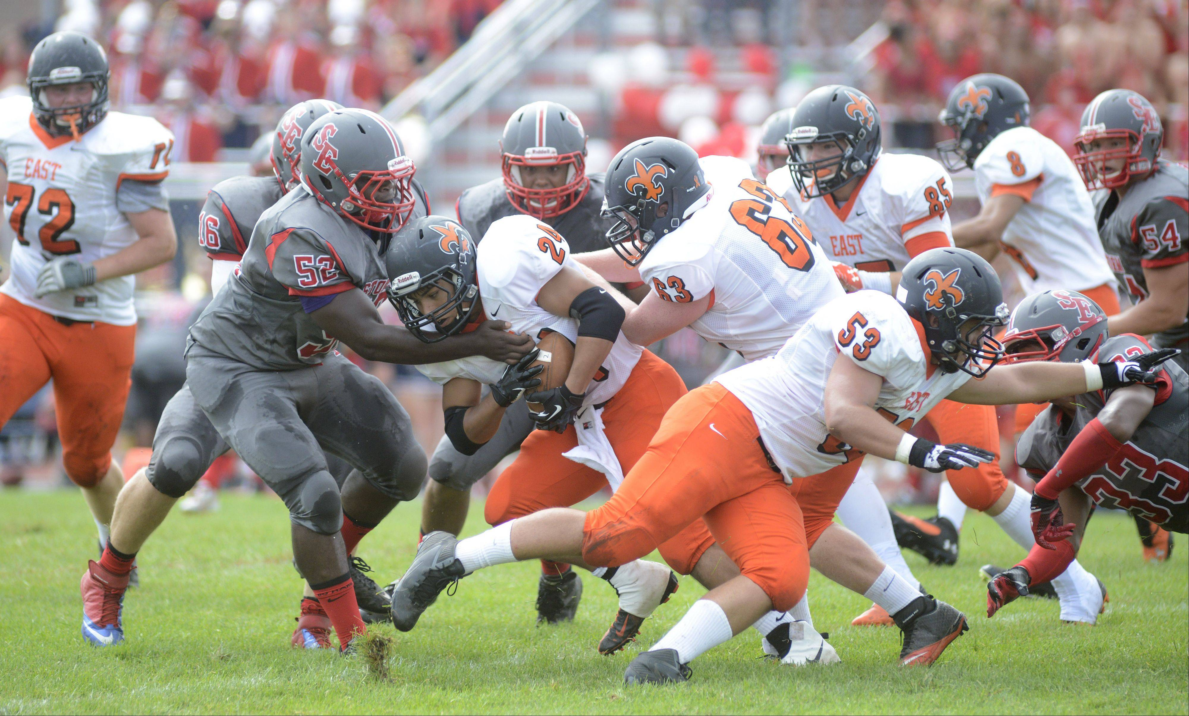 South Elgin's Antchill Thomas stops St. Charles East's Ramon Lopez cold in the second quarter on Saturday, August 31.