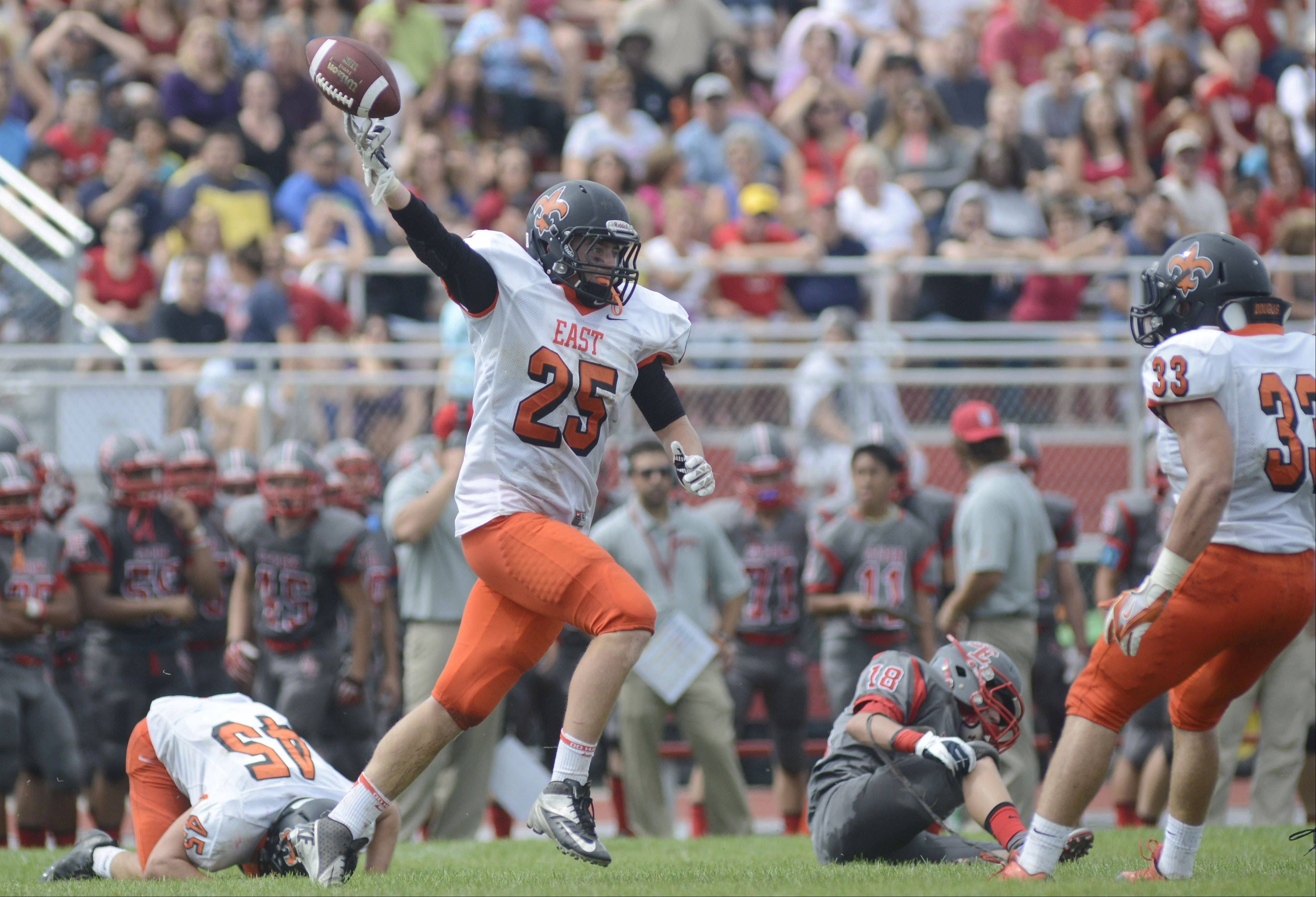 St. Charles East's Scott Roback celebrates an interception in the first quarter on Saturday, August 31.