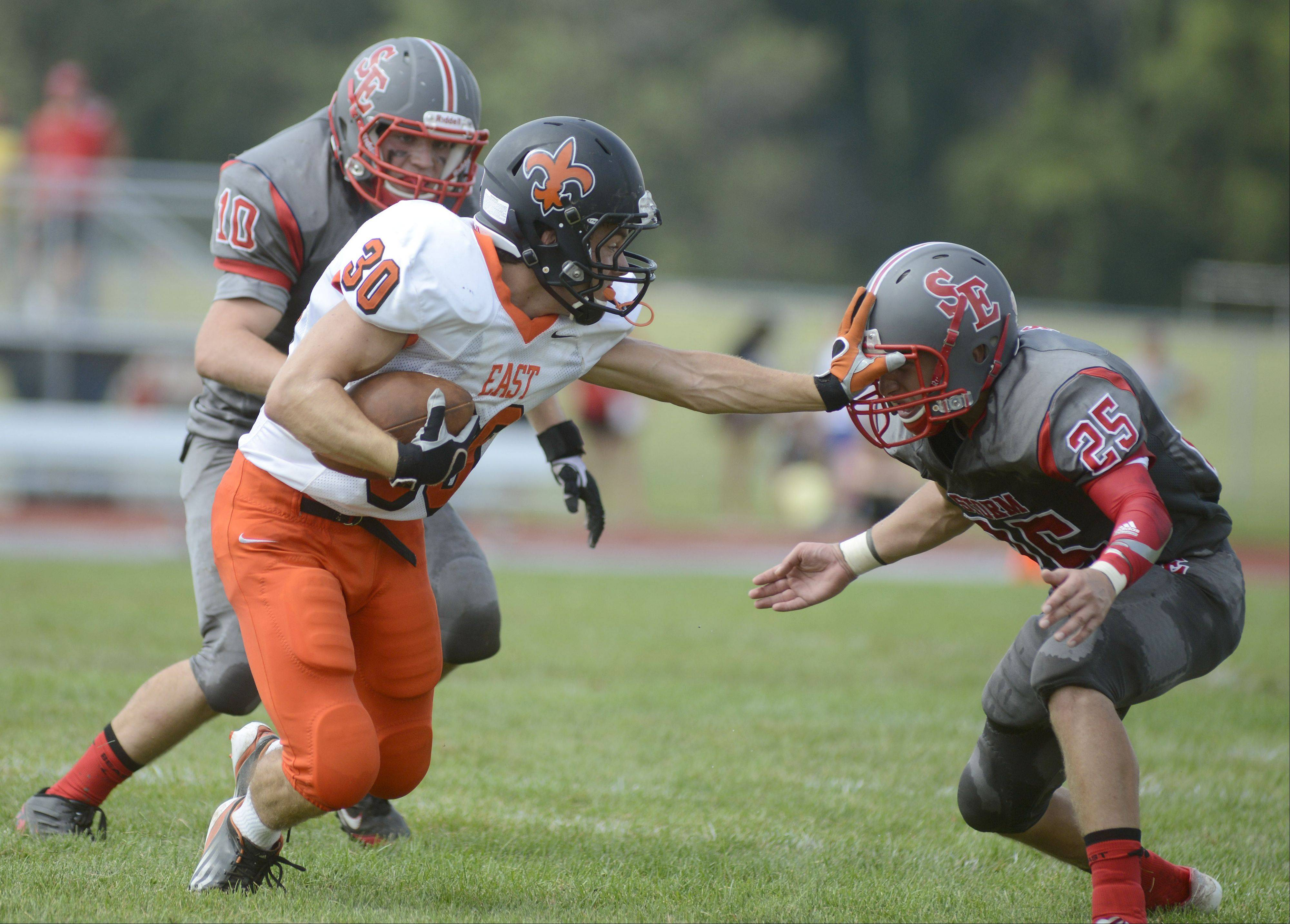 St. Charles East's Mitch Munroe strong-arms South Elgin's Nino Arredondo in the first quarter on Saturday, August 31.