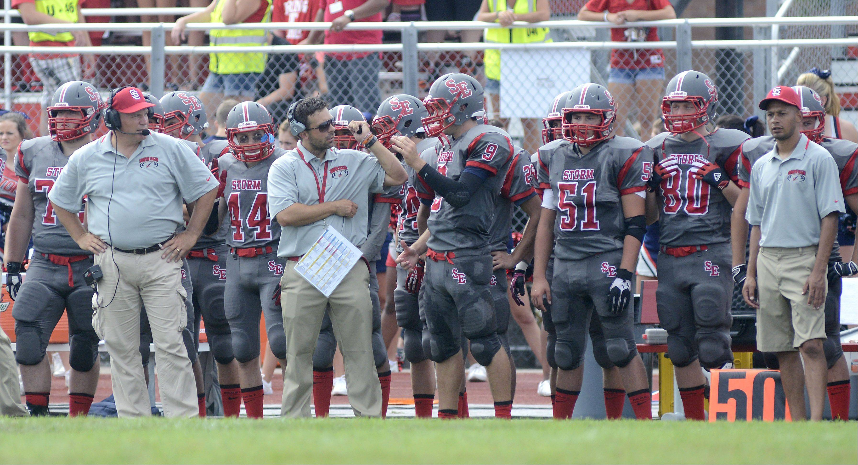 South Elgin coach Pat Pistorio, second from left, on the sidelines with players on Saturday, August 31.